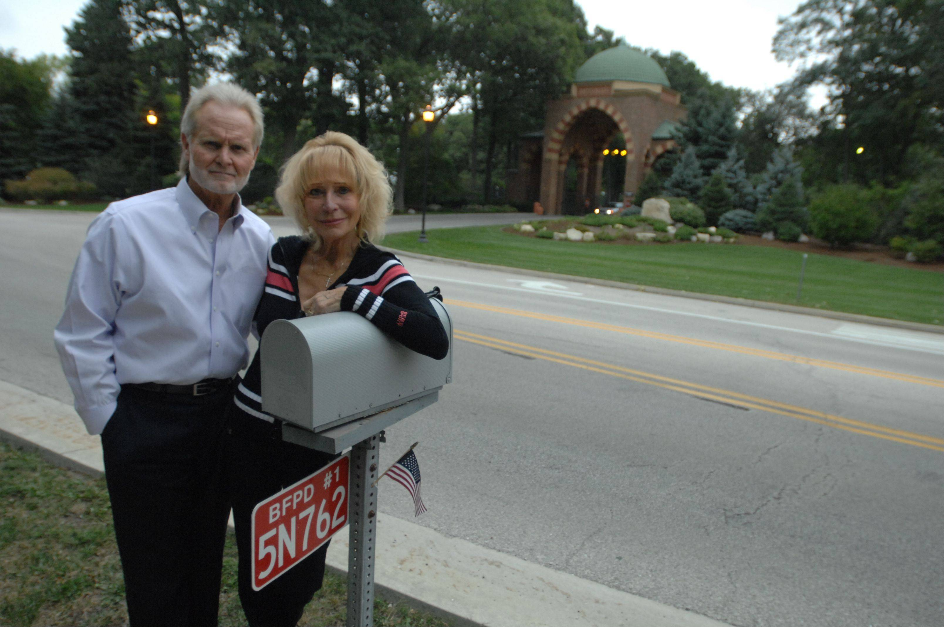 "Pat and Ralph Cook live across the street from the front gates of Medinah Country Club. They're fine with the crowds that will come with the Ryder Cup. ""If you don't like the inconvenience, then don't buy a house across from Medinah Country Club,"" Pat Cook said."