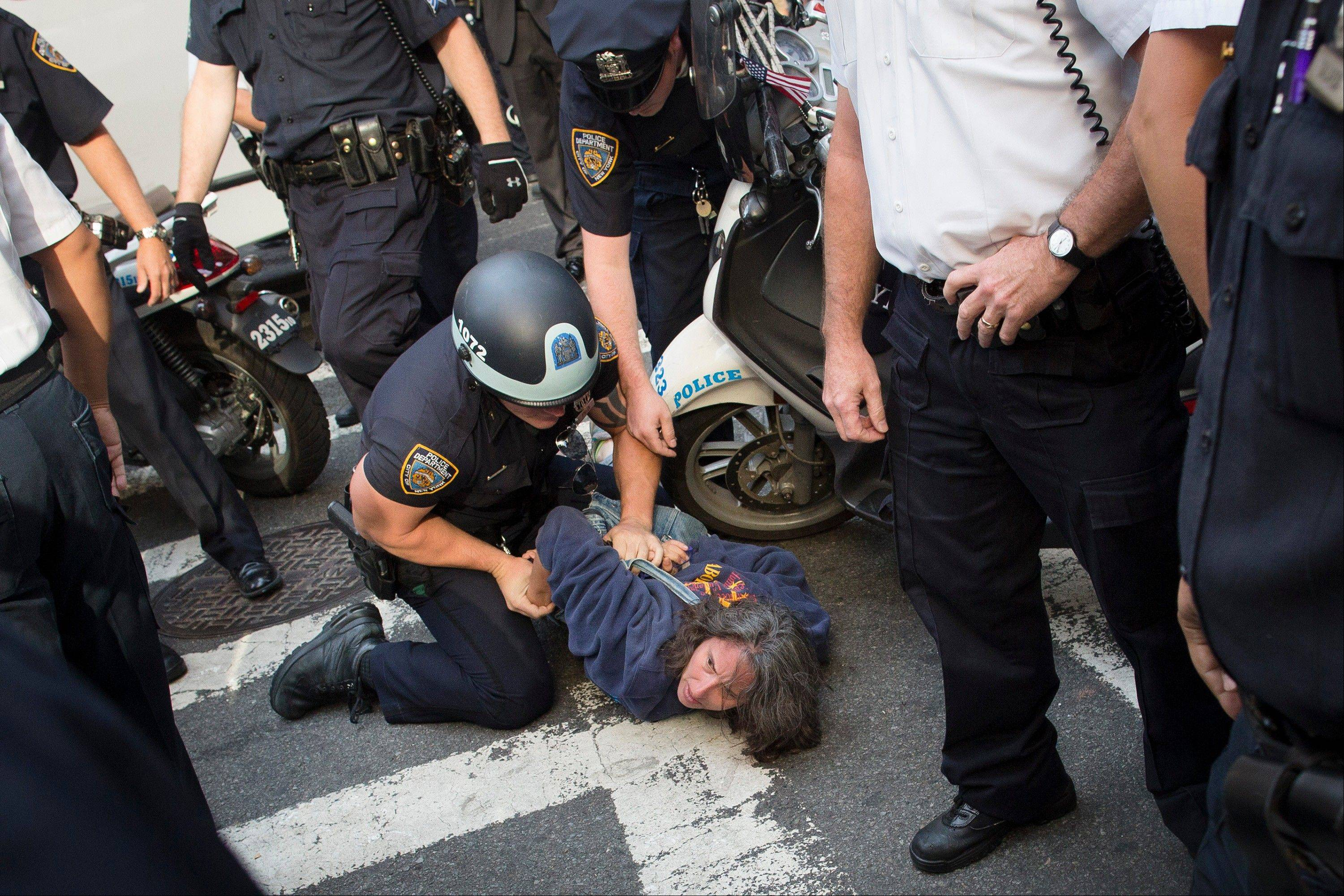 Anna Roblin is arrested during an Occupy Wall Street march in New York. A handful of Occupy Wall Street protestors were arrested during a march toward the New York Stock Exchange on the anniversary of the grass-roots movement.