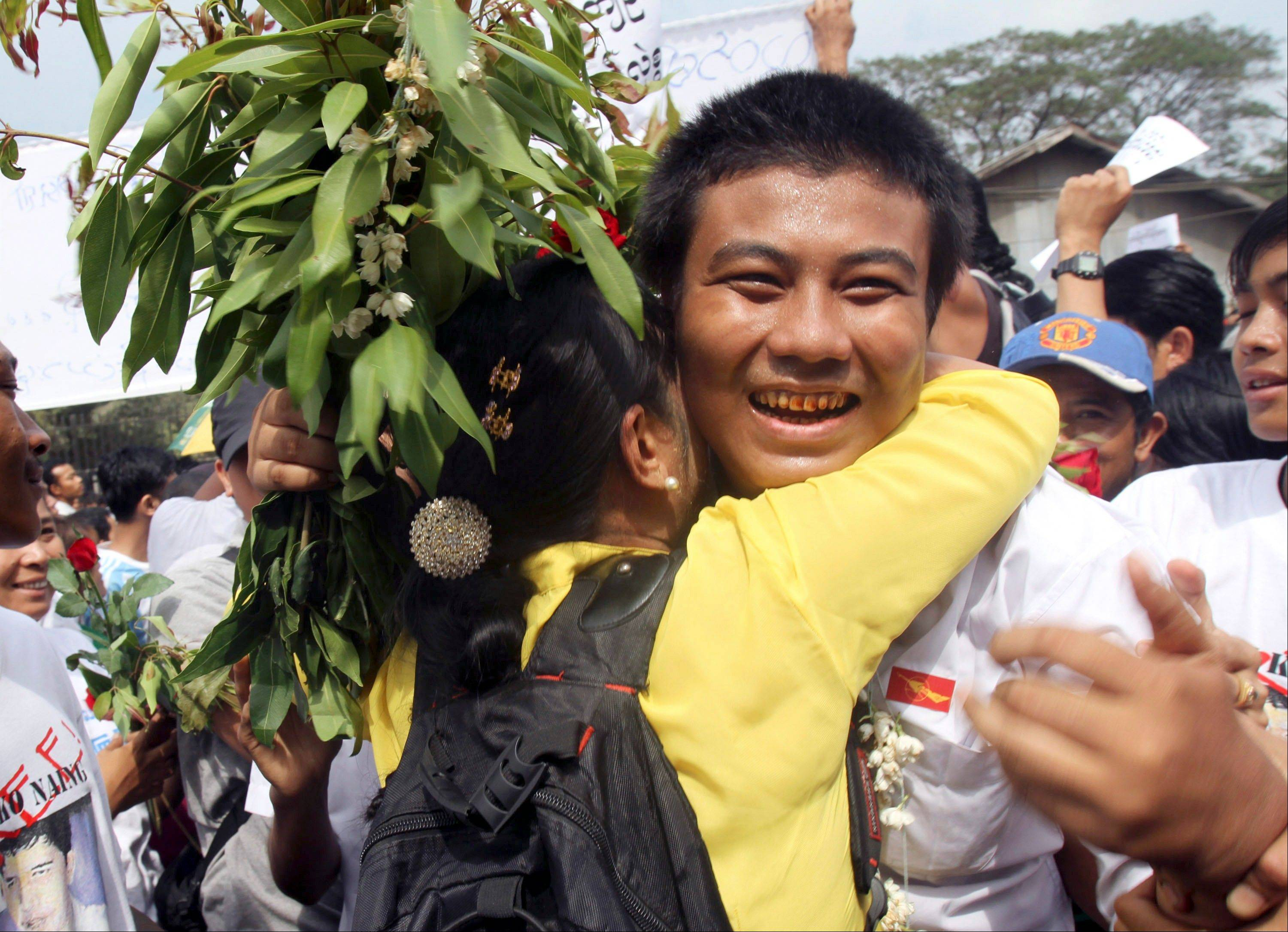A freed Myanmar political prisoner, right, is welcomed by his friend as he comes out of Insein prison in Yangon, Myanmar, in January. Myanmar's government said Monday it has granted amnesties for 514 prisoners, including some foreigners, on humanitarian grounds.