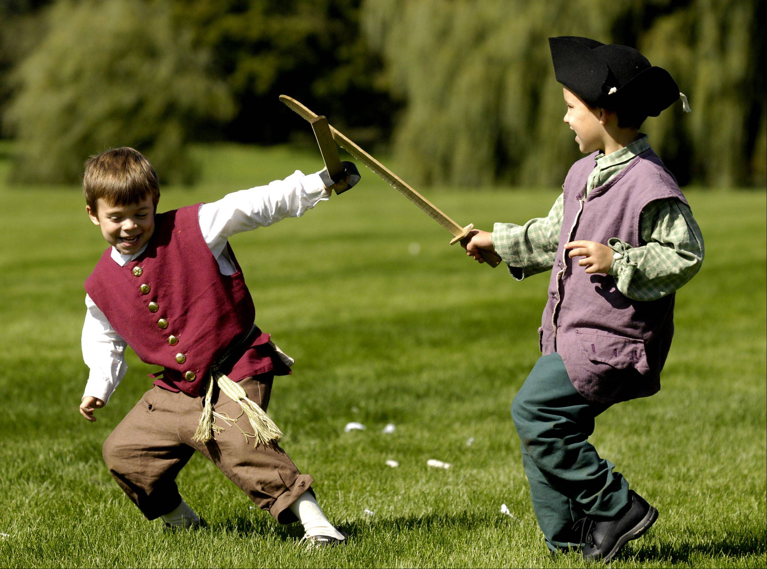 James LeRoy, 6, of Kankakee and Mason Broski, 6, of Hobart, Indiana battle it out during the Revolutionary War Re-enactment weekend at Cantigny Park in Wheaton, Sunday.