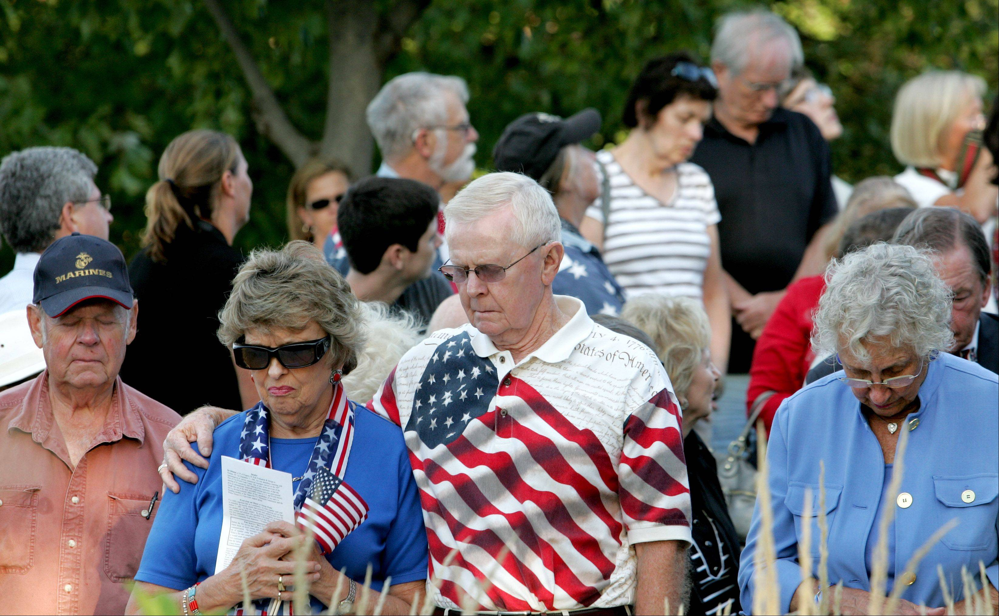A moment of silence is observed during the annual September 11 remembrance at the Cmdr. Dan Shanower Memorial in Naperville on Tuesday.