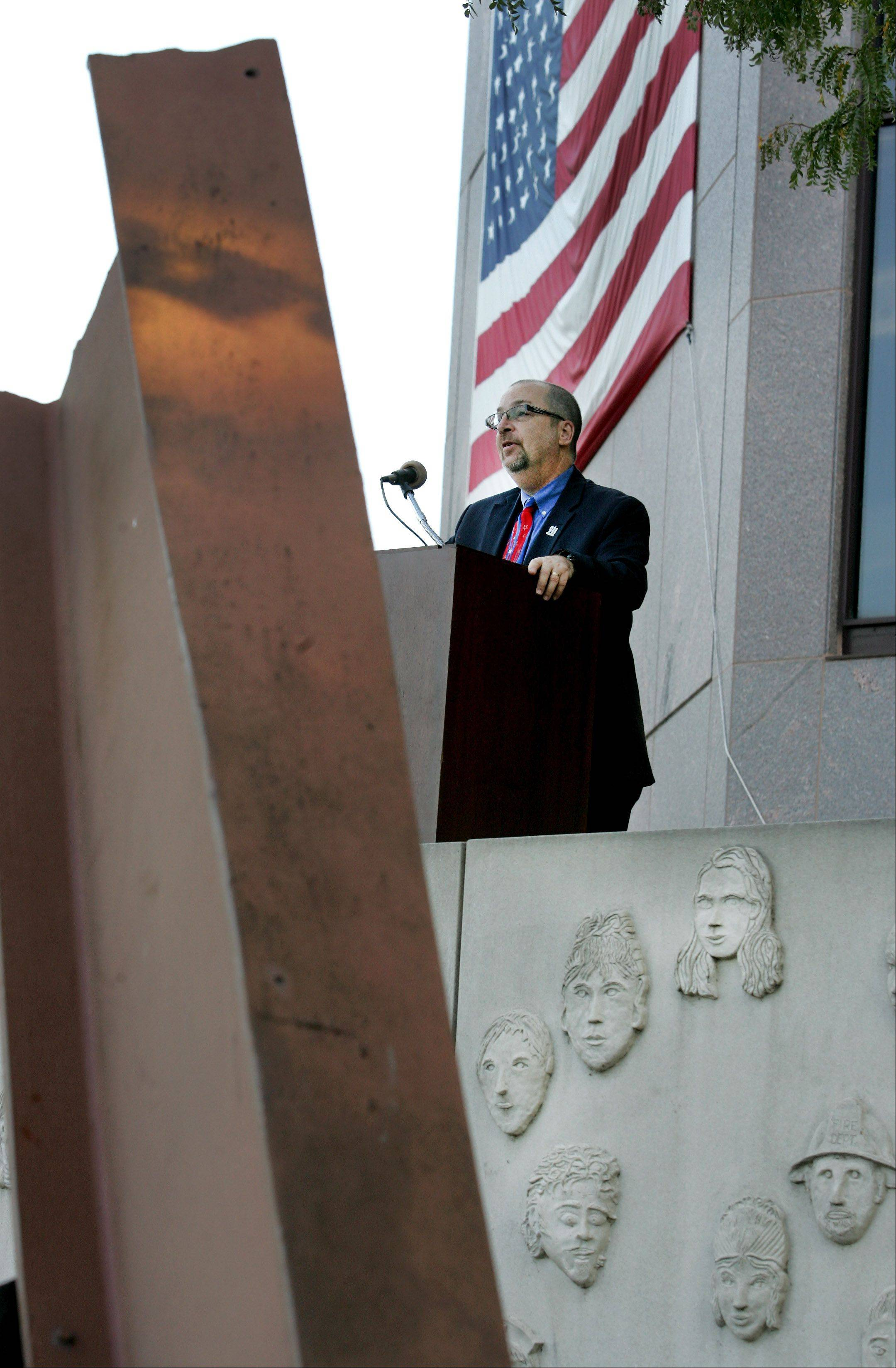 Joe Dittmar shares his experiences at the annual September 11 remembrance at the Cmdr. Dan Shanower Memorial in Naperville on Tuesday. On September 11, 2001, Dittmar was attending a meeting on the 105th floor of Two World Trade Center with 54 executives from various commercial insurance carriers. He and six others survived that day.