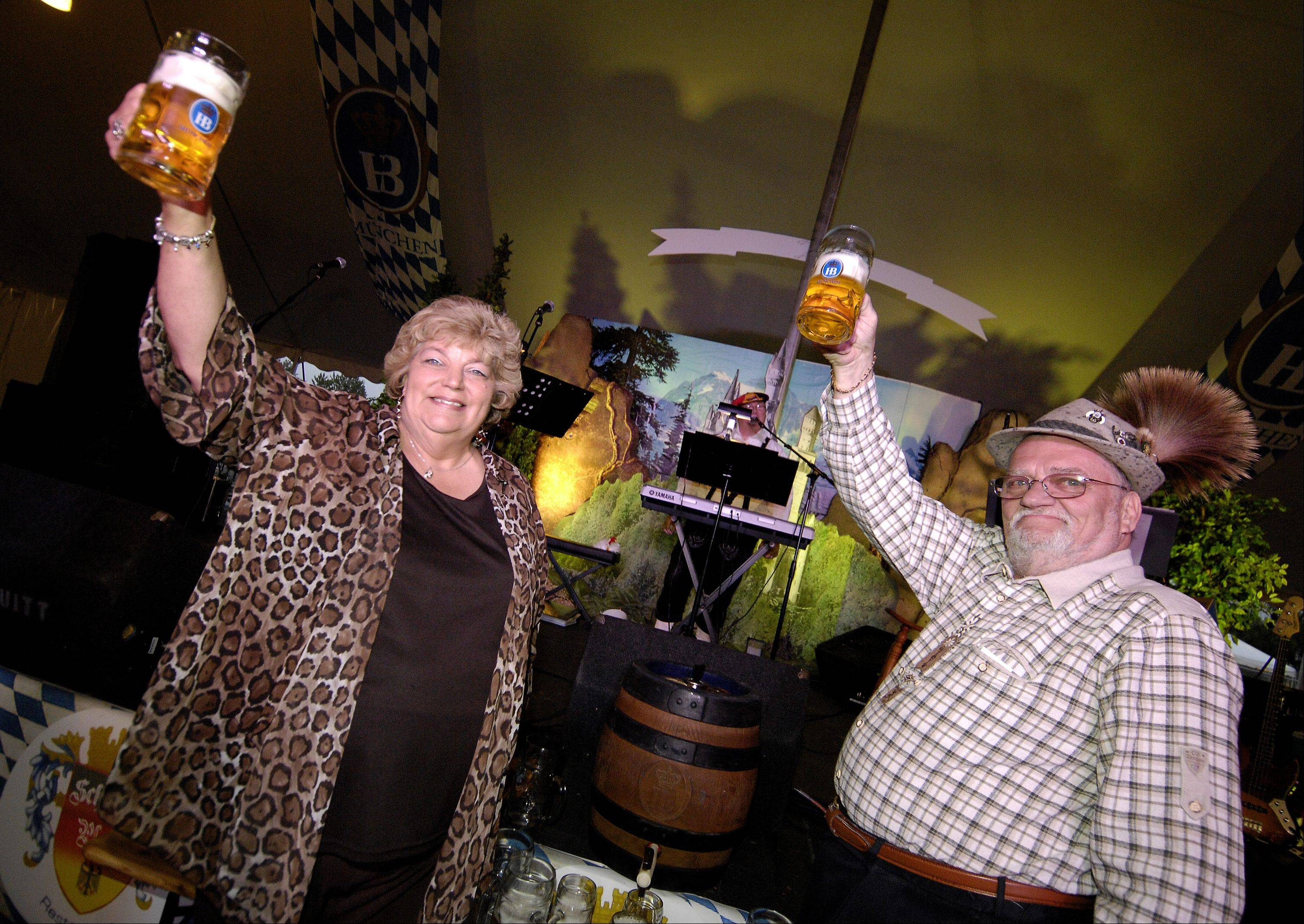 Glendale Heights Mayor Linda Jackson and Wolfgang Beyer kick off the Oktoberfest with the tapping of the first keg, Thursday at Camera Park.