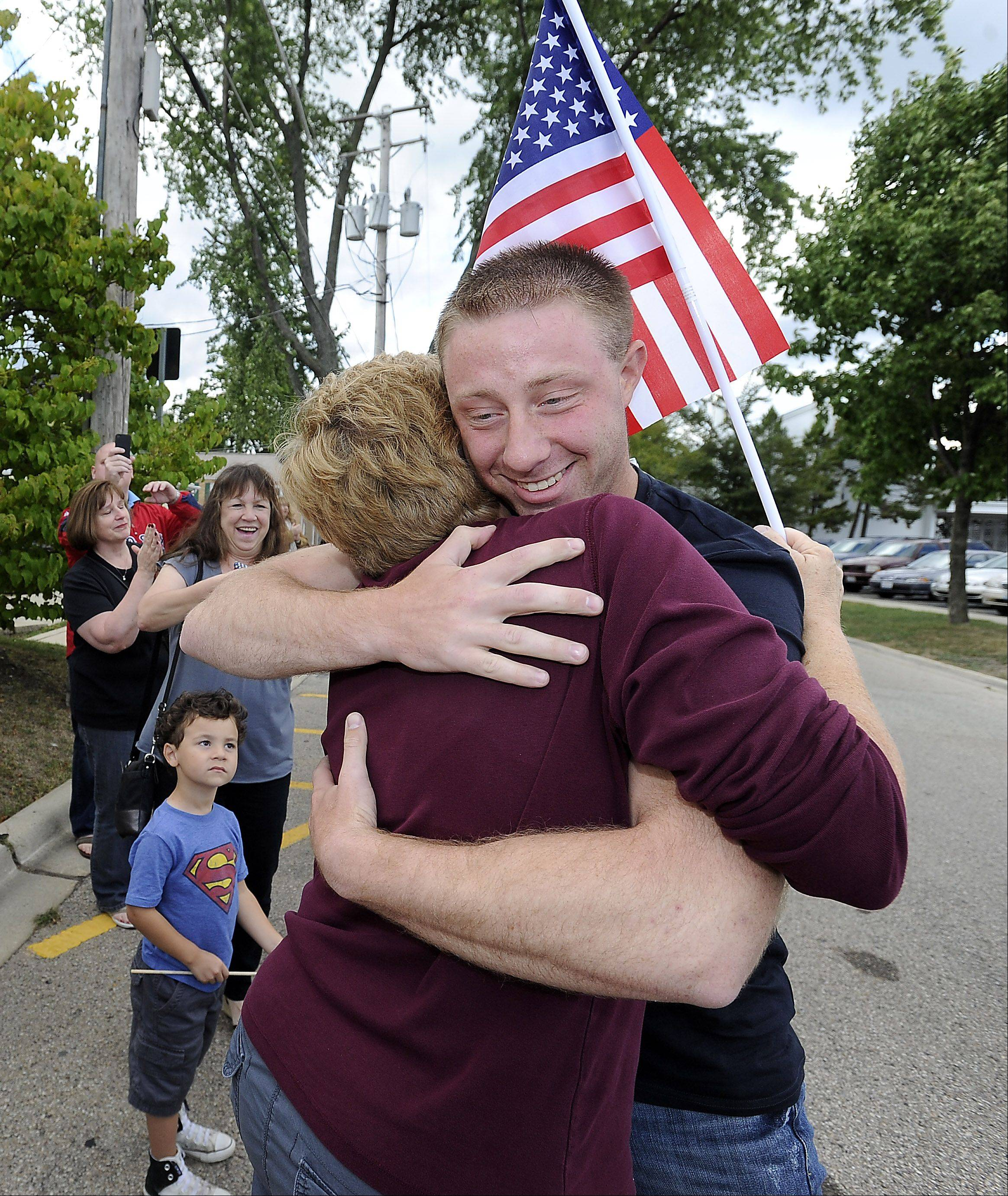 A overwhelmed Gari Buergin, grandmother to Cpl. Marcus Kuiper, 22, of Barrington welcomes him home after his second tour in Afghanistan to Barrington on Saturday.