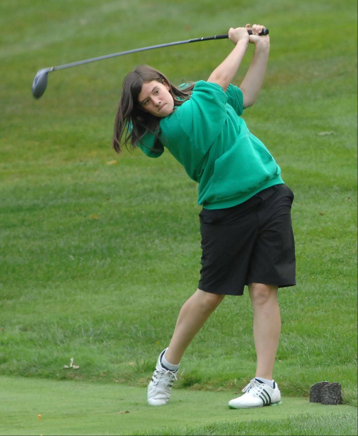 Ryann Scully of St. Edward drives off the tee Monday at the Elgin Country Club girls golf invitational.