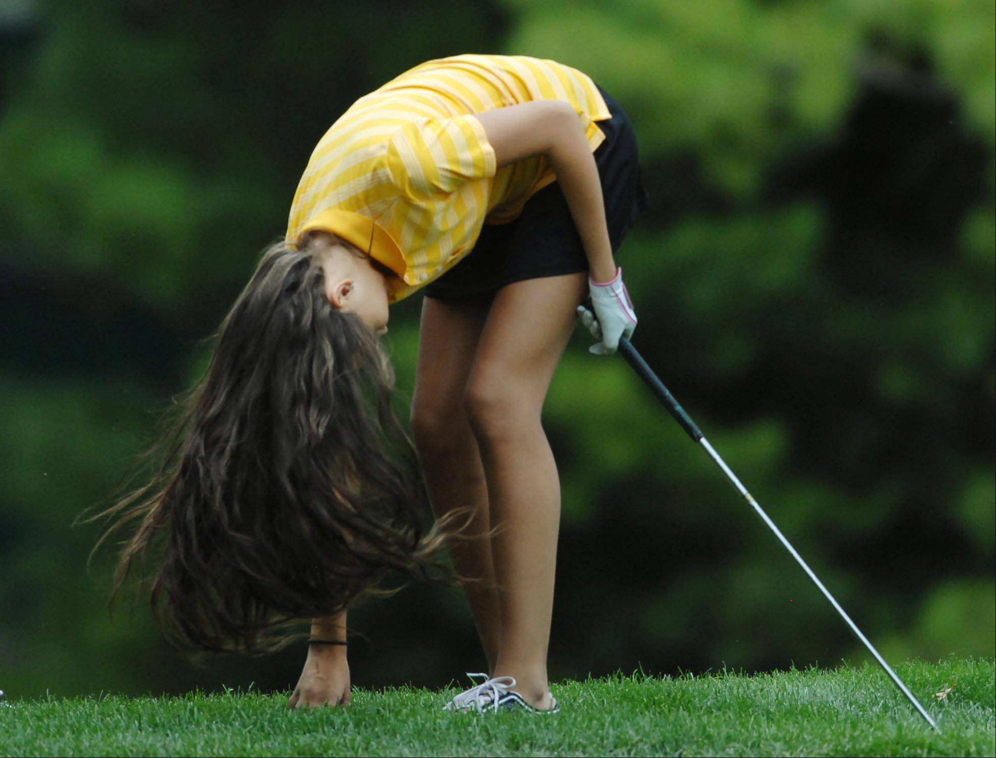 Carly Andersen of Jacobs throws her head down after missing a chip shot Monday at the Elgin Country Club girls golf invitational.