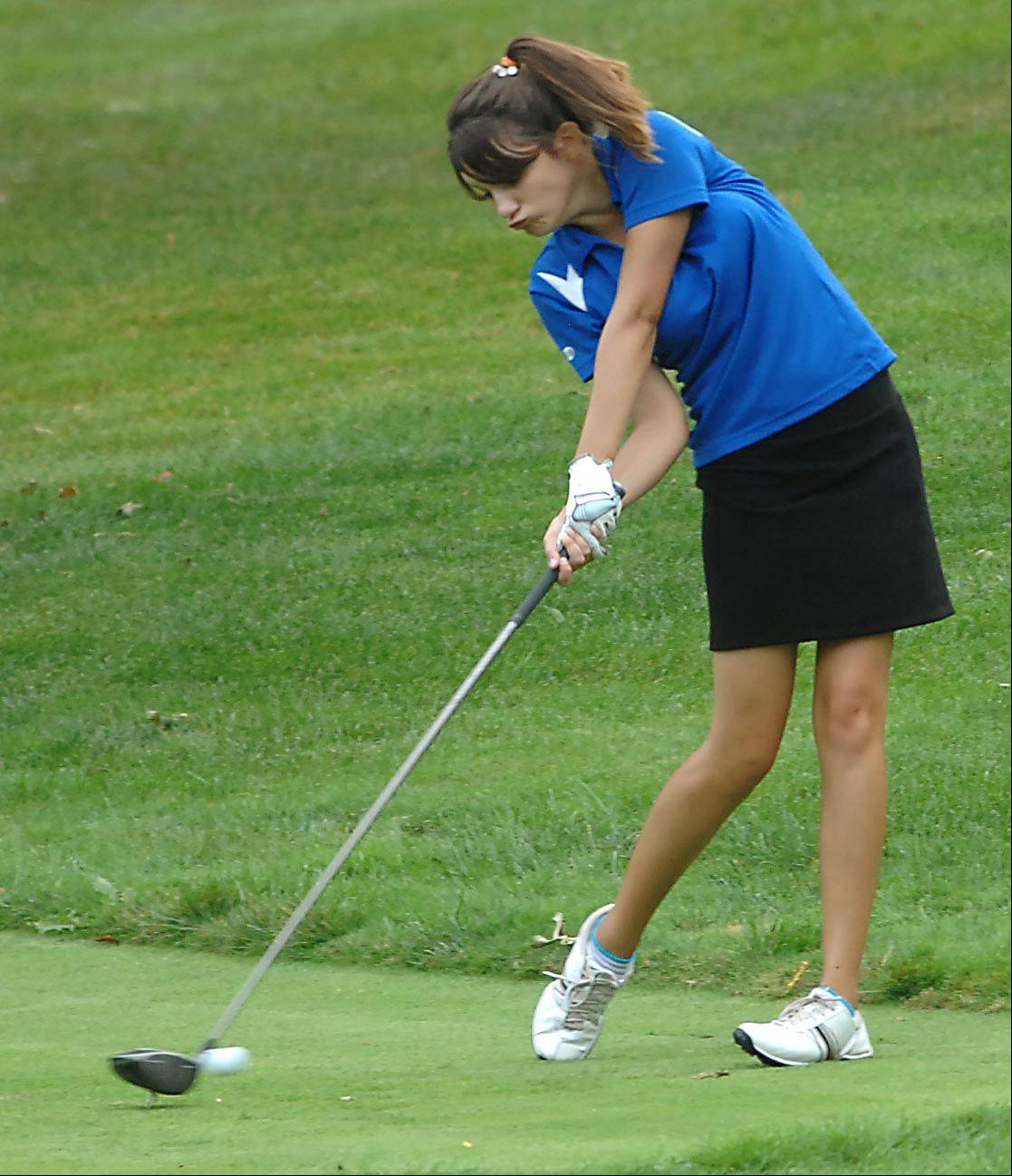 Alison Smith of Larkin/Elgin Co-op connects on the tee Monday at the Elgin Country Club girls golf invitational.