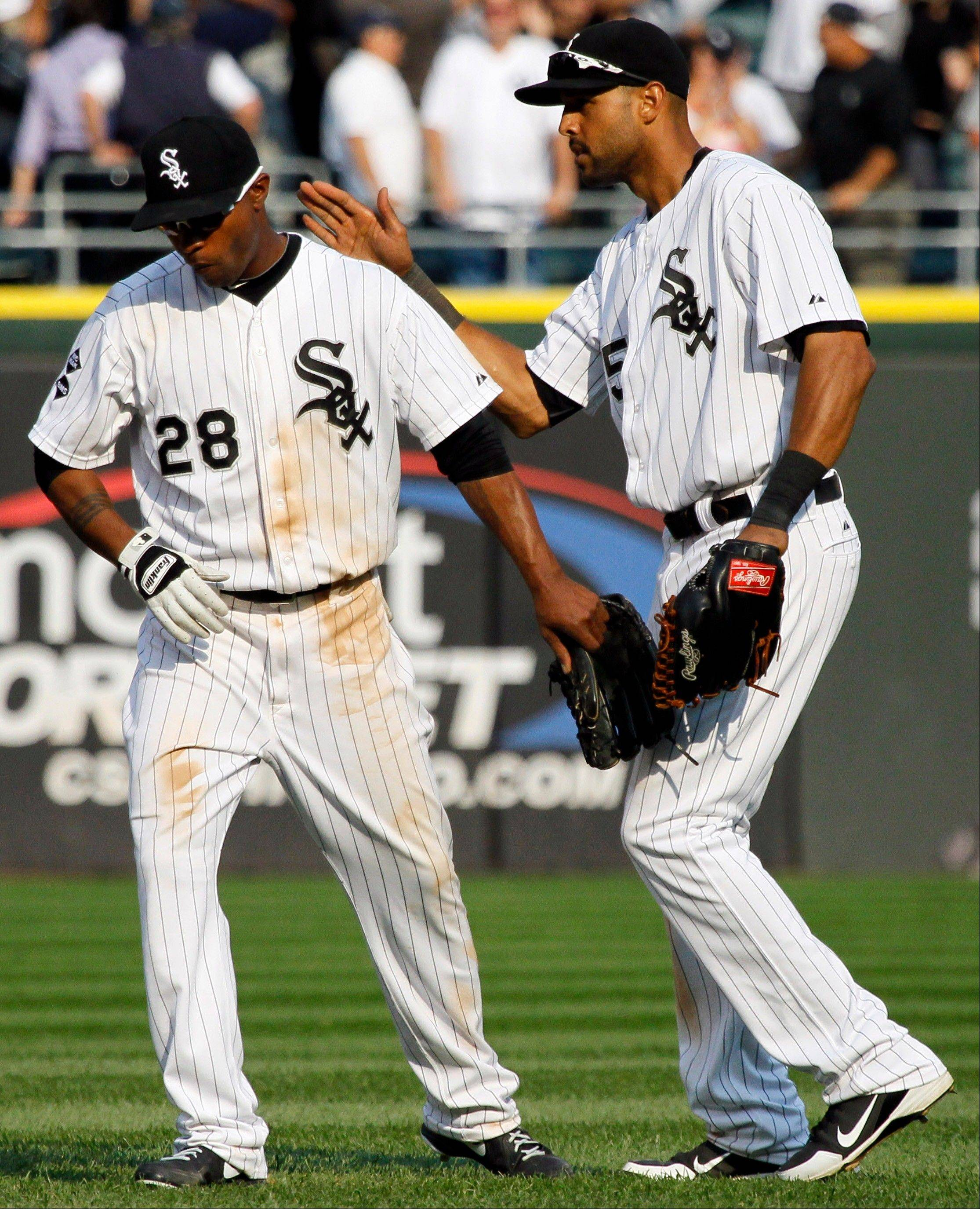 White Sox right fielder Alex Rios pats center fielder Dewayne Wise on the back after Monday's victory over the Detroit Tigers at U.S. Cellular Field.