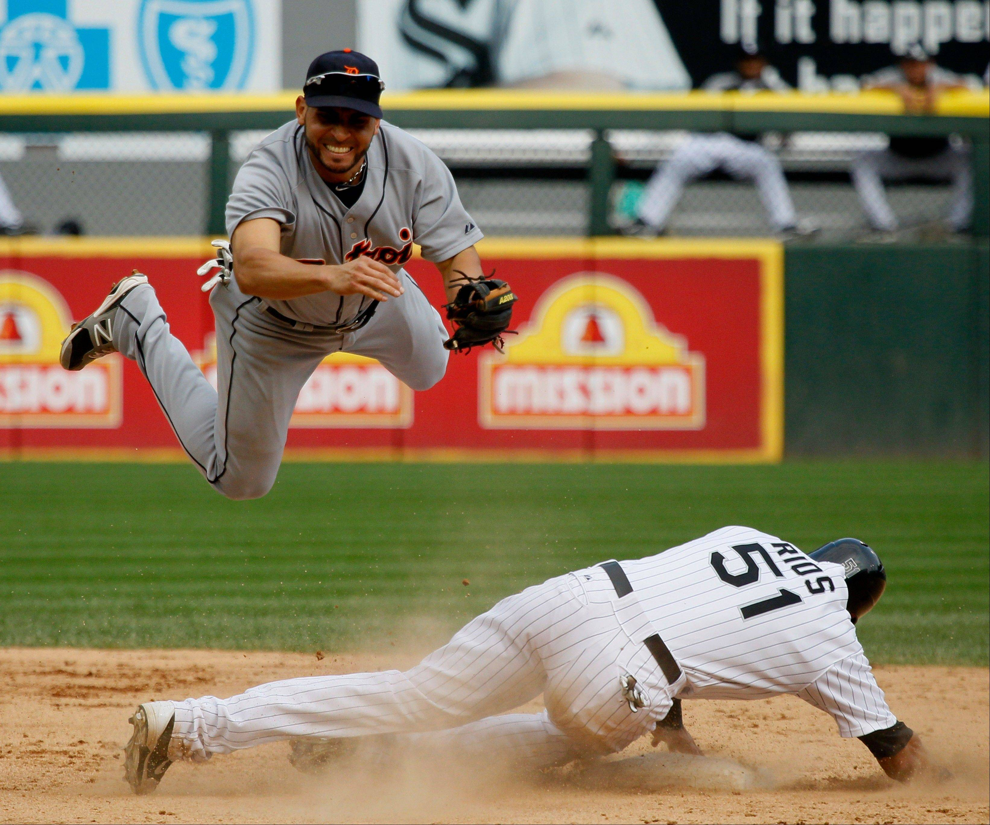 Detroit Tigers second baseman Omar Infante tries to complete the double play forcing White Sox outfielder Alex Rios out at second during Monday's fifth inning at U.S. Cellular Field. Rios foiled the double play, allowing Adam Dunn and Paul Konerko to score off a fielders choice hit by Dayan Viciedo.