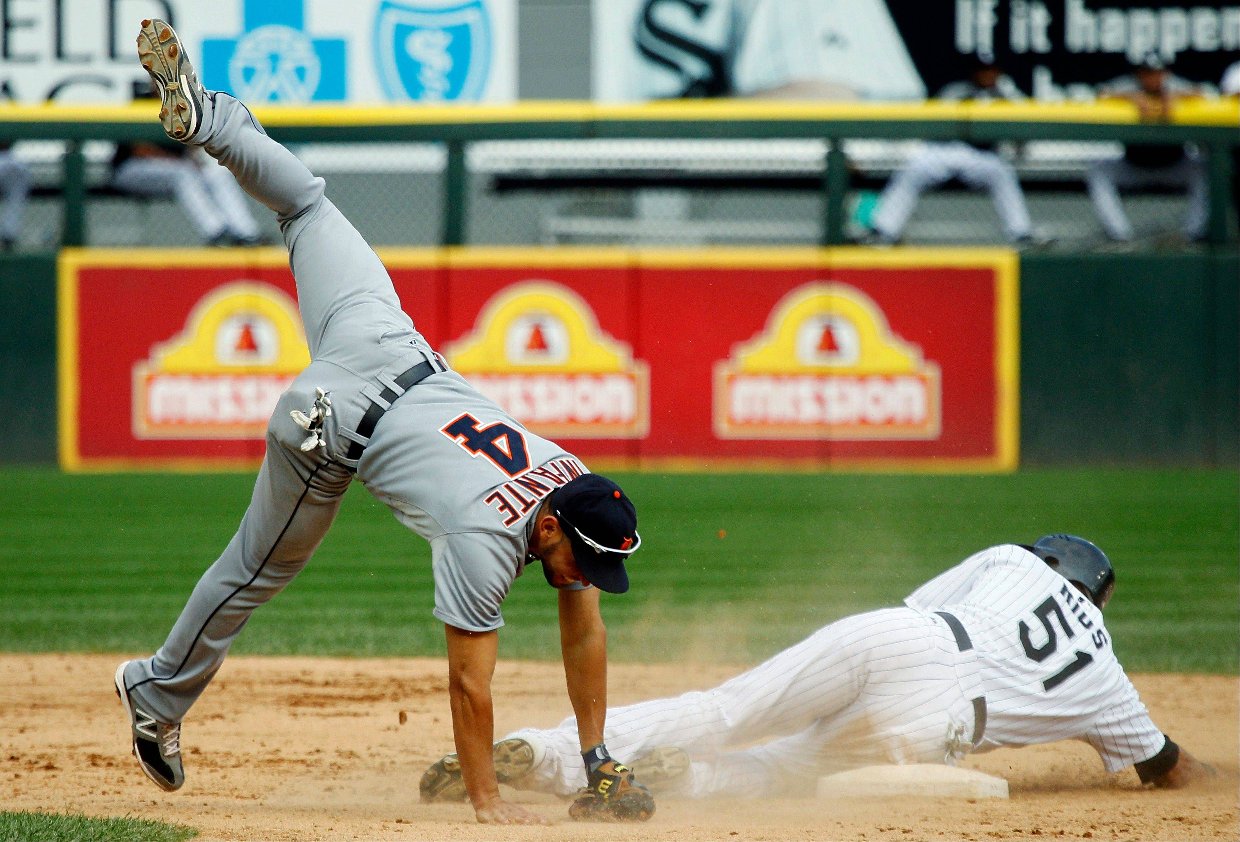 Detroit Tigers second baseman Omar Infante is upended trying to complete the double play by White Sox outfielder Alex Rios during Monday's fifth inning at U.S. Cellular Field.