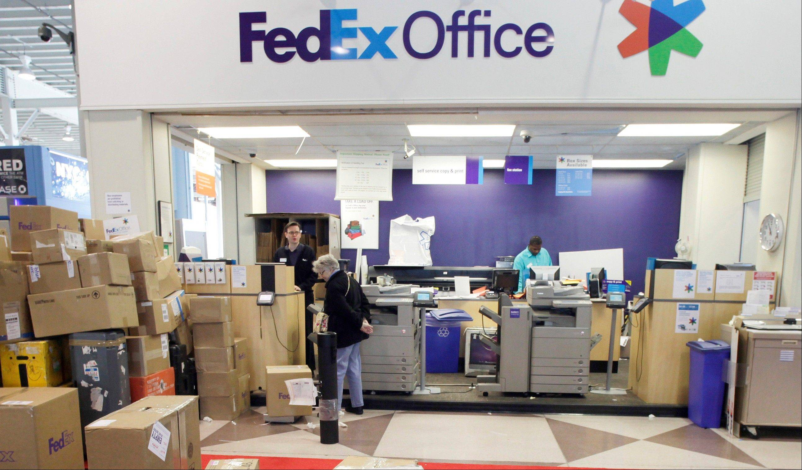 FedEx says the global economy is worsening and it's again cutting its forecast for the fiscal year ending in May.