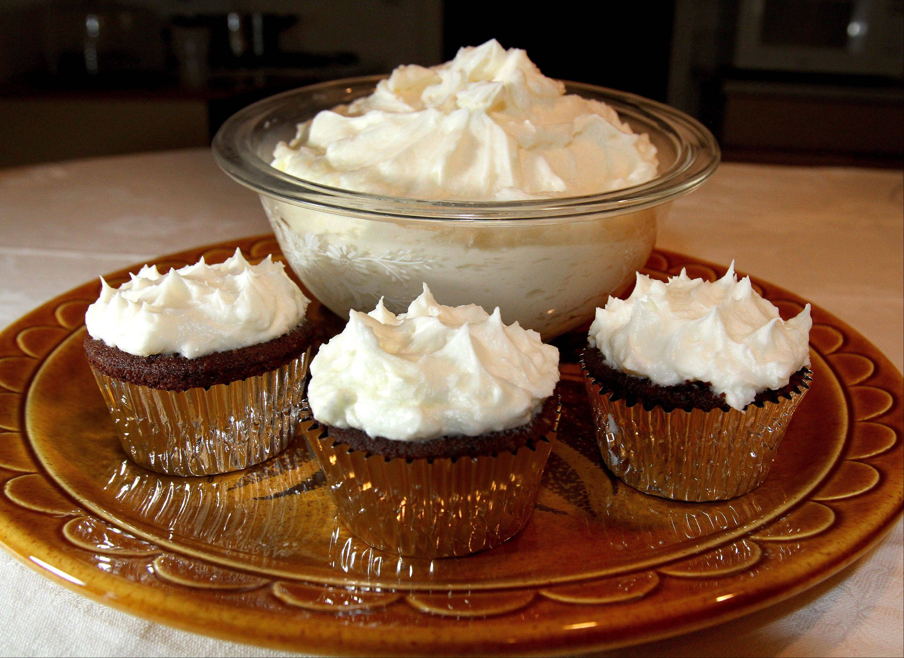 Butter and orange-flavoring make this frosting a good fit for after-school cupcakes or a tiered wedding cake.