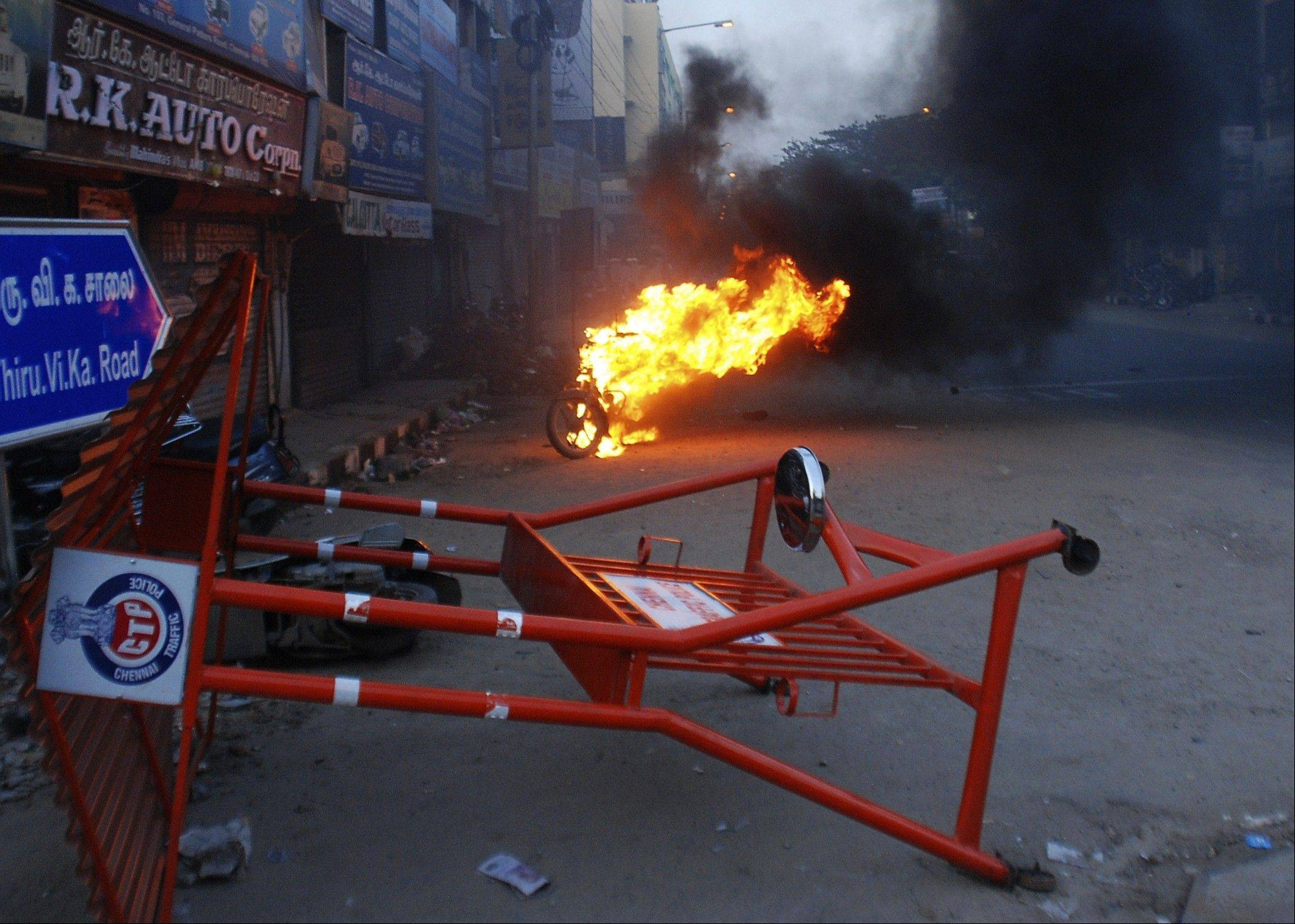 A motorcycle goes up in flames during a protest in front of the U.S. embassy in Chennai, India. Saudi Arabaia, in attempt to avoid this sort of protests over the anti-Islam film that ridicules Islam's Prophet Muhammad, blocked YouTube on Tuesday to prevent the film from being seen.