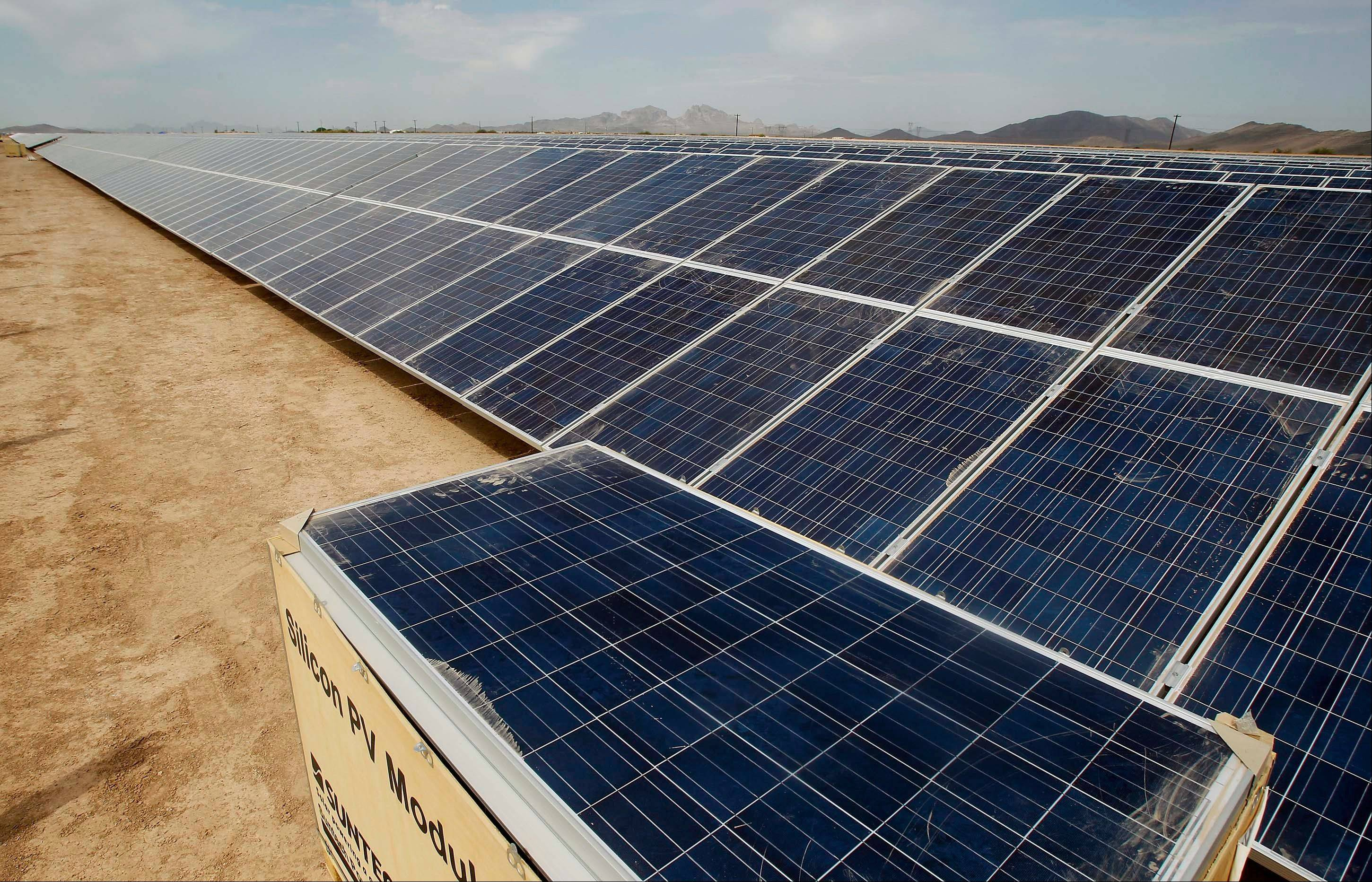 Solar panel installation is seen at the Mesquite Solar 1 facility in Arlington, Ariz. Even as renewable power projects get a boost from the federal government, there's a tangle of complications preventing states like New Mexico and Arizona from converting the obvious potential into real watts.