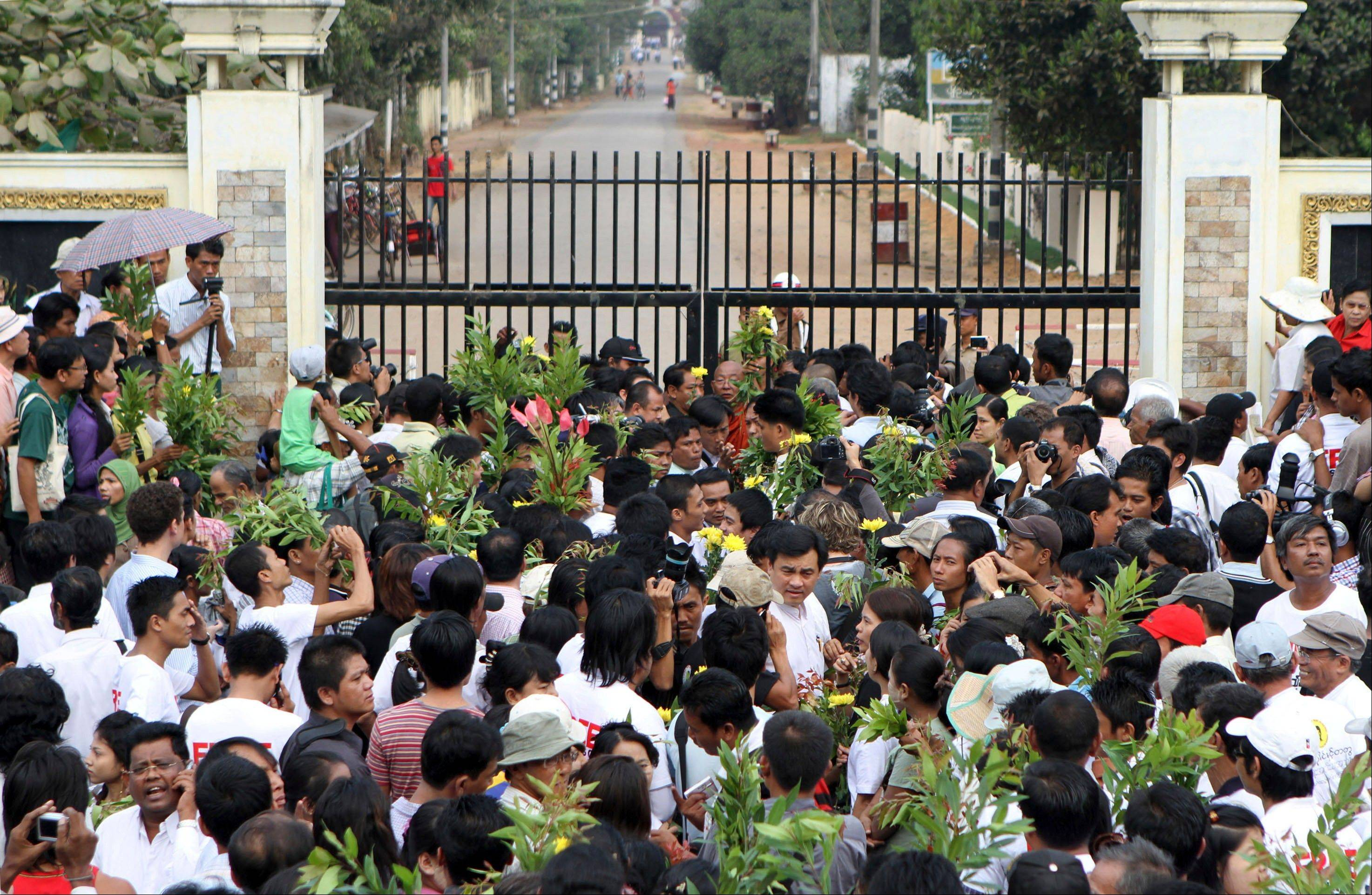 In this file photo, family members of Myanmar prisoners wait in front of Myanmar's notorious Insein prison in Yangon, Myanmar, as they hope their relatives and colleagues will be freed. Myanmar's government said Monday, Sept. 17, 2012 it has granted amnesties for 514 prisoners, including some foreigners, on humanitarian grounds.