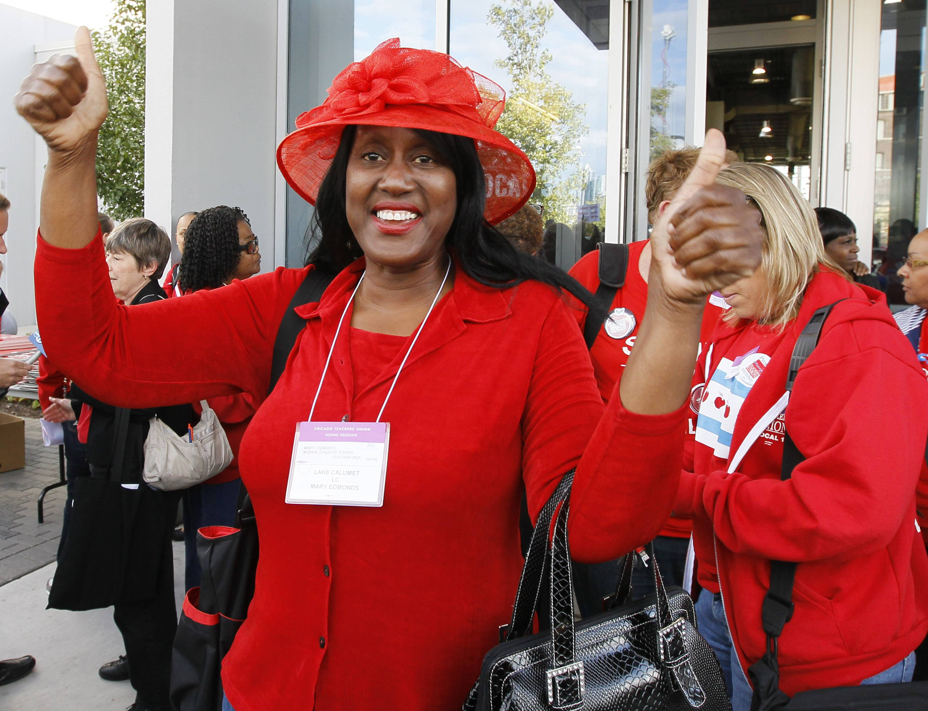 Mary Edmonds, a member of the Chicago Teachers Union's House of Delegates, celebrates Tuesday after the delegates voted to suspend the strike against the school district. The city's teachers agreed to return to the classroom after more than a week on the picket lines, ending a spiteful stalemate with Mayor Rahm Emanuel that put teacher evaluations and job security at the center of a national debate about the future of public education.