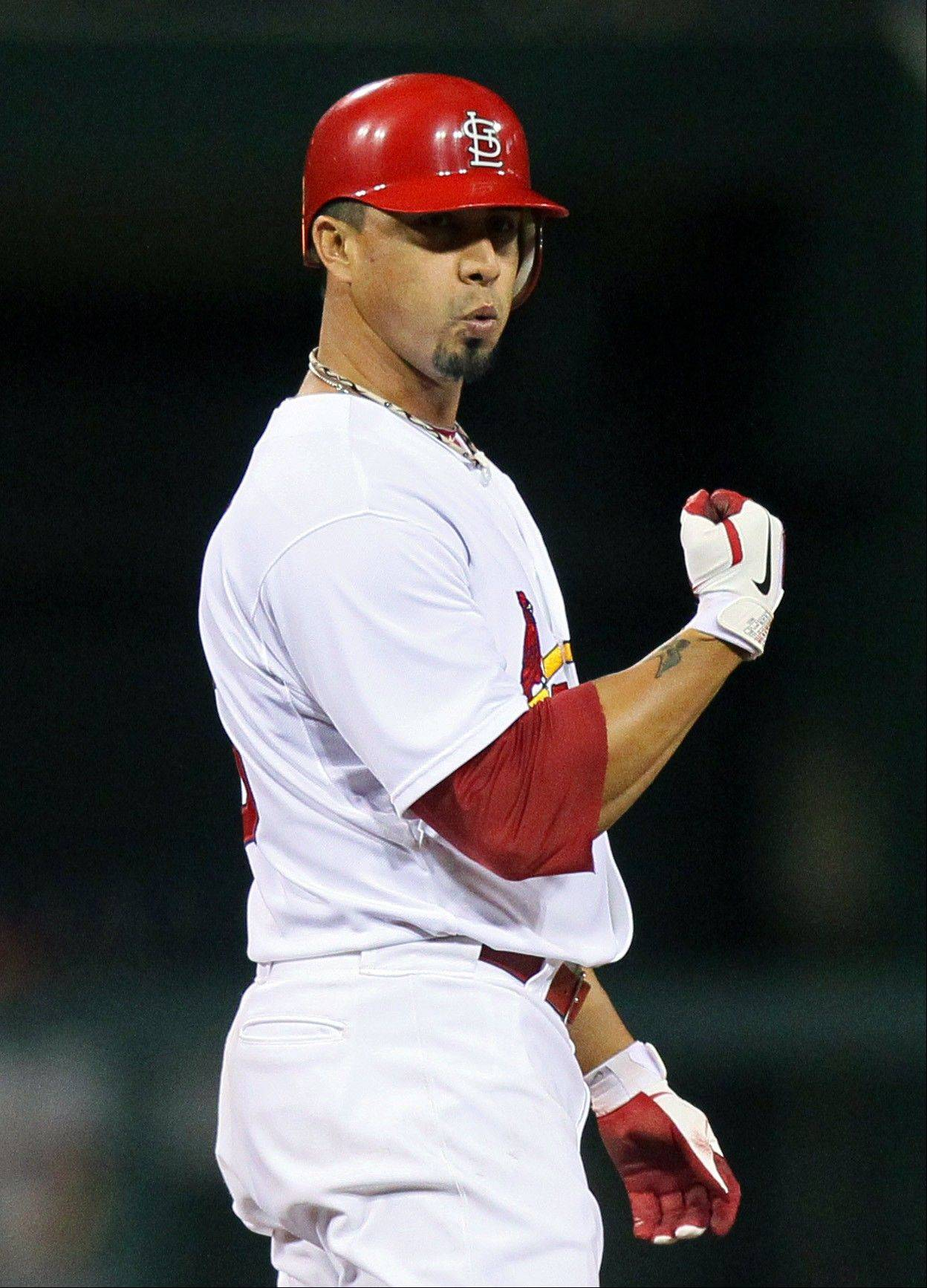 In addition to pitching seven scoreless innings, the Cardinals' Kyle Lohse hit an RBI double Tuesday in a victory over Houston in St. Louis.