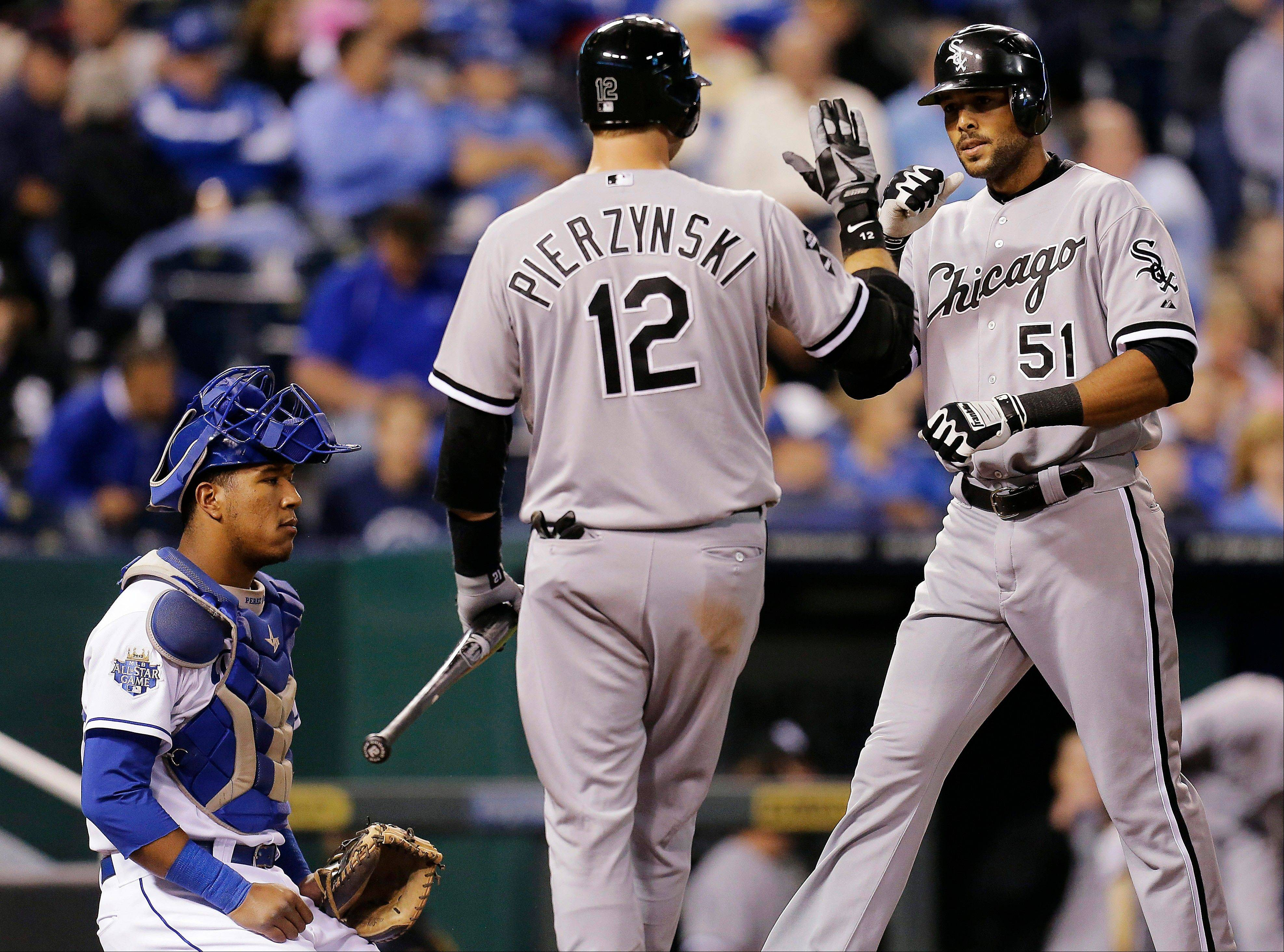 White Sox catcher A.J. Pierzynski celebrates Tuesday with Alex Rios after Rios hit a solo home run during the seventh inning against the Kansas City Royals.