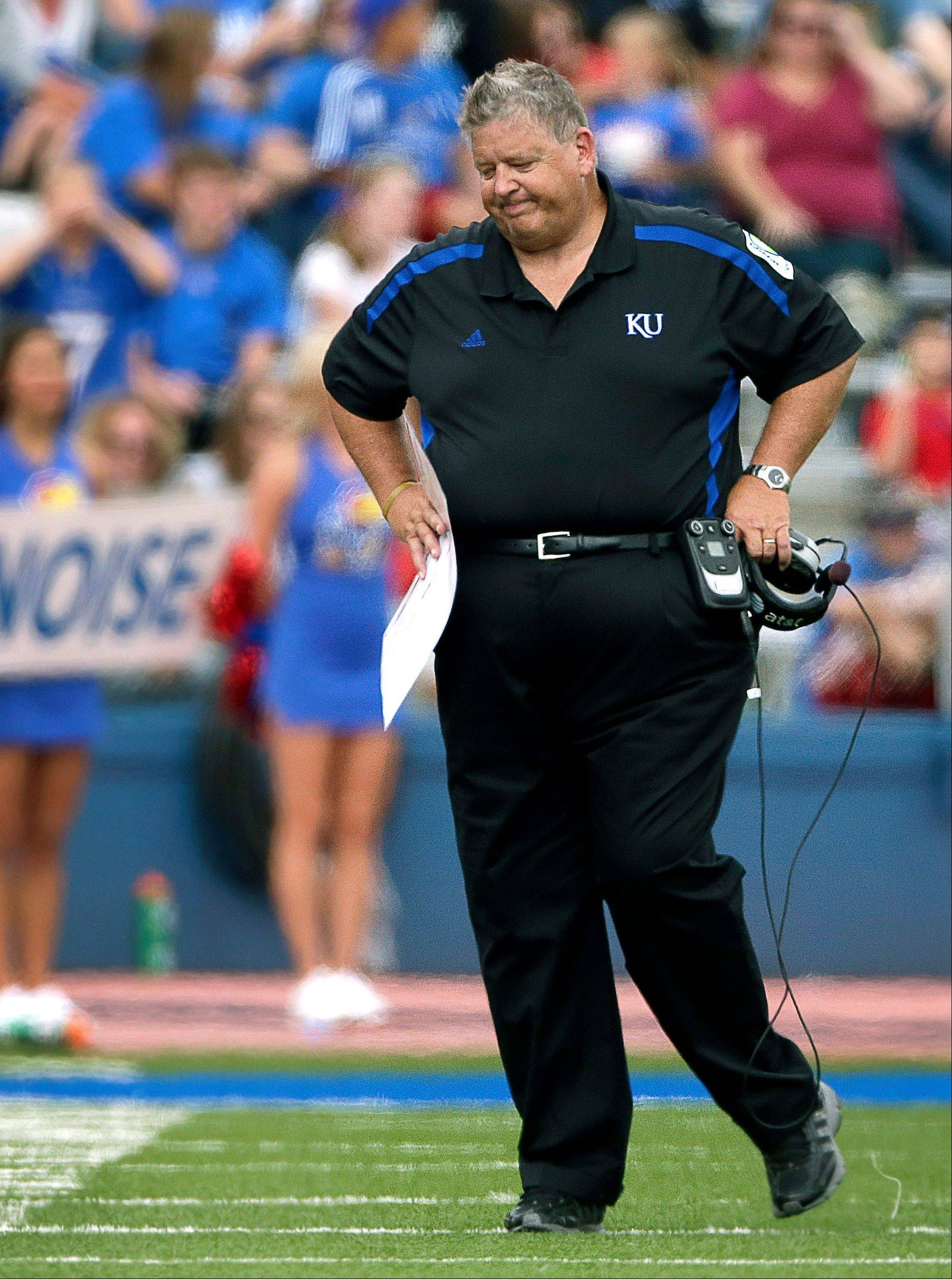Kansas head coach Charlie Weis reacts to a penalty Saturday during the second half against TCU in Lawrence, Kan. TCU won the game 20-6.