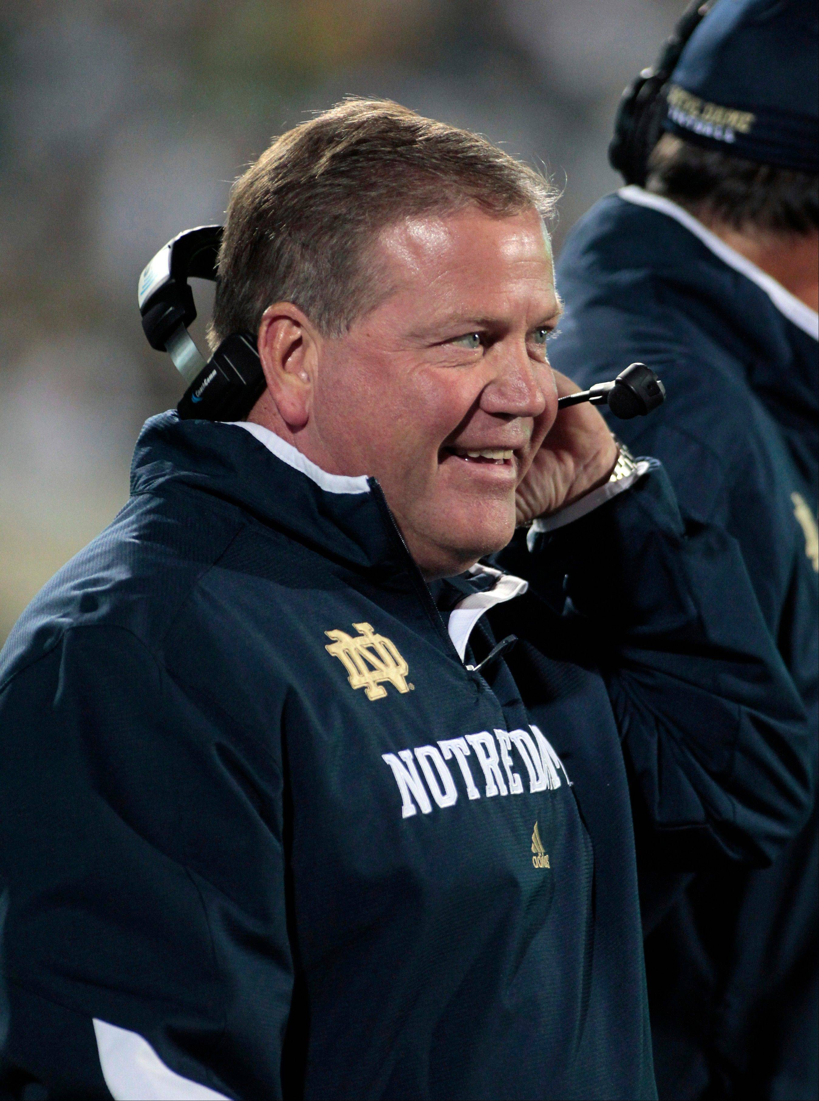 Notre Dame coach Brian Kelly stands on the sideline Saturday during the first quarter against Michigan State.