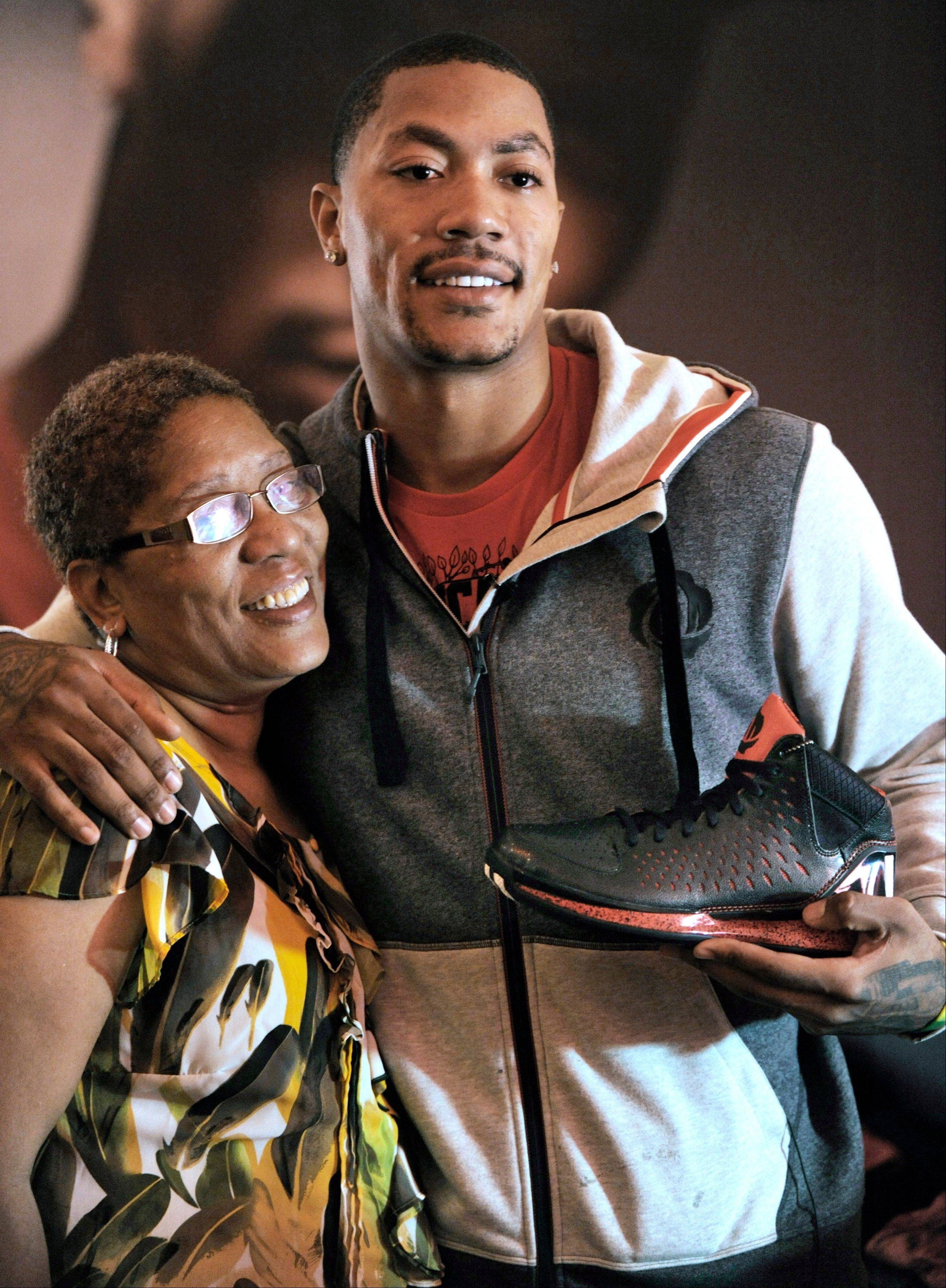 Bulls guard Derrick Rose, shown here with his mother Brenda after unveiling his new shoe the adidas D Rose 3, shows the kind of emotions that endear him to Chicagoans, says Mike North.