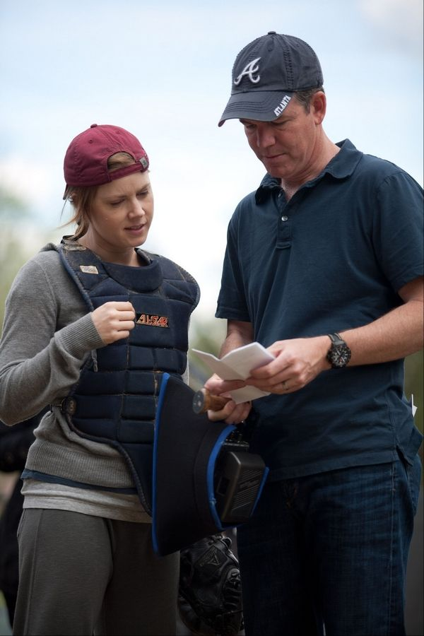 "Fremd High School graduate Robert Lorenz directs Amy Adams in a scene from Lorenz's directorial debut ""Trouble With the Curve,"" opening Friday."