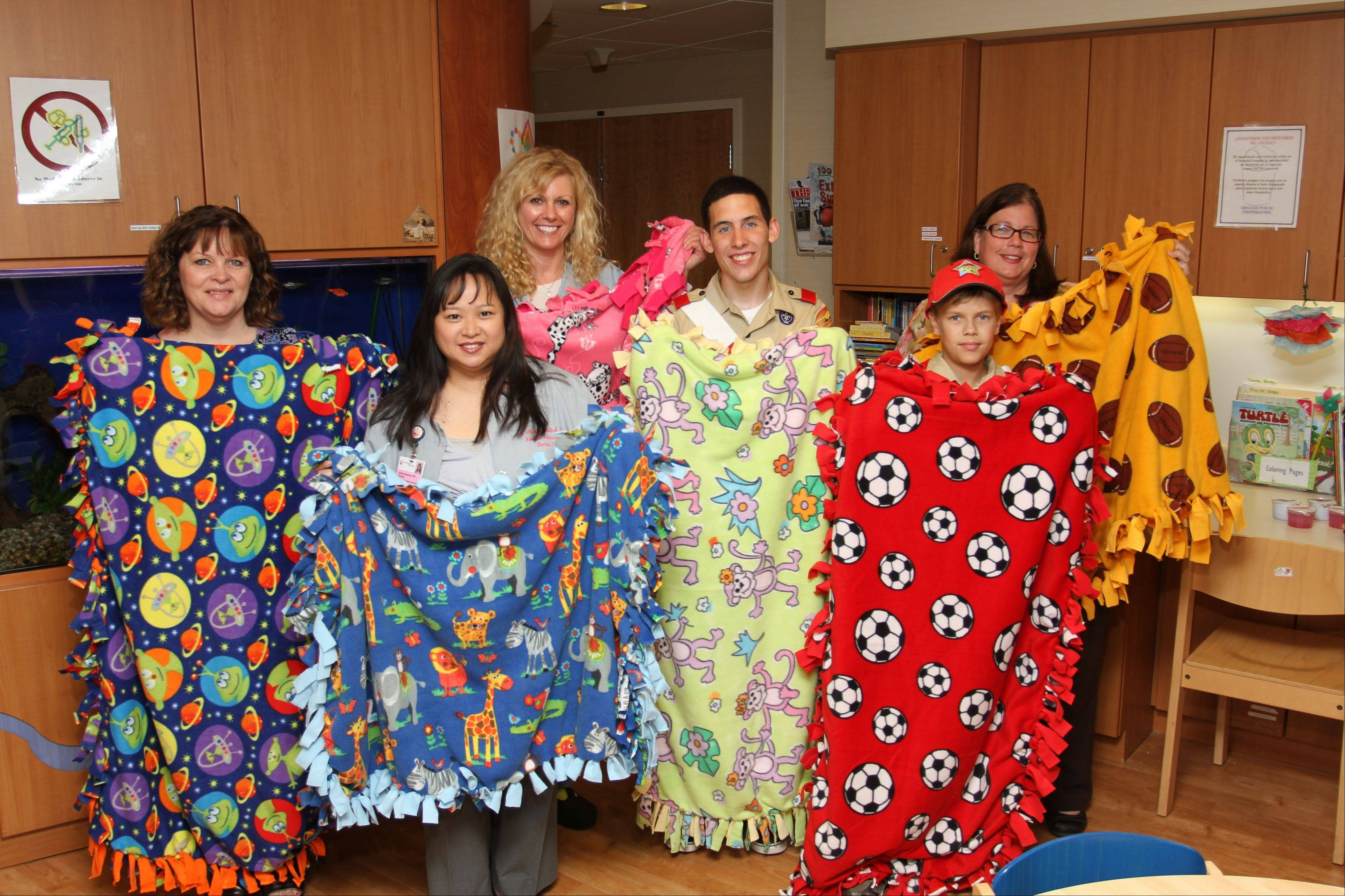 As his Eagle Scout project, Jeffery Weaver, along with a team of volunteers, made 50 fleece blankets for the patients of St. Alexius Medical Center's Pediatric Unit.