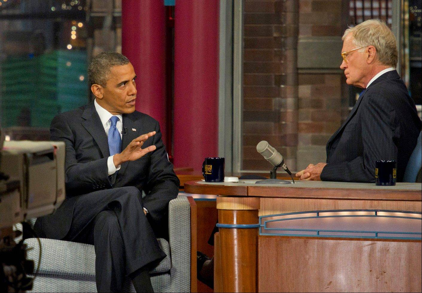 "President Barack Obama speaks with host David Letterman on the set of the ""Late Show with David Letterman"" Tuesday in New York."