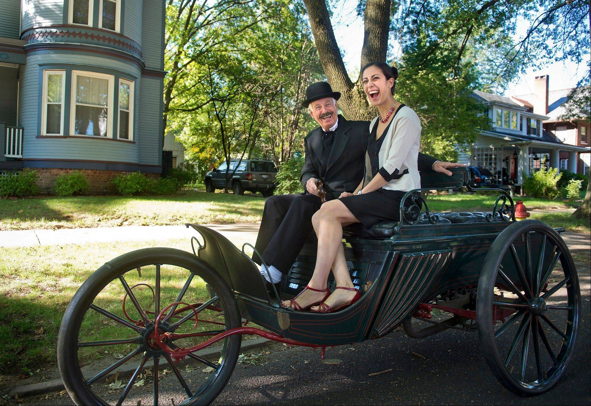Peoria Regional Museum Society president John Parks, left, laughs with Kelly Kolton as the Duryea Trap, an early gas-powered car built in 1898 in Peoriamade a brief visit back to the place of it's creation.
