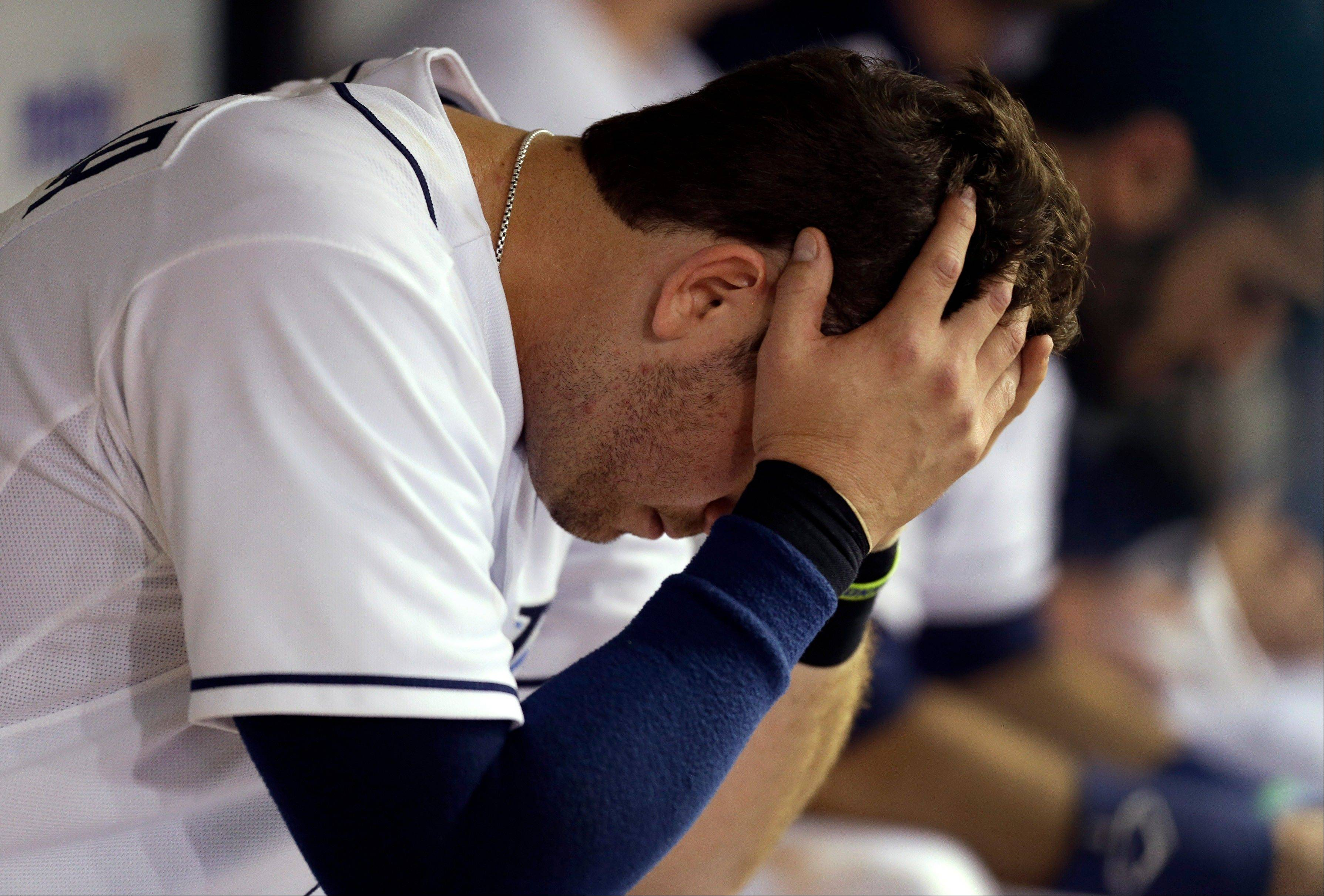 Tampa Bay's Evan Longoria sits in the dugout during the eighth inning of the Rays' 7-5 loss to the Boston Red Sox on Tuesday at home.