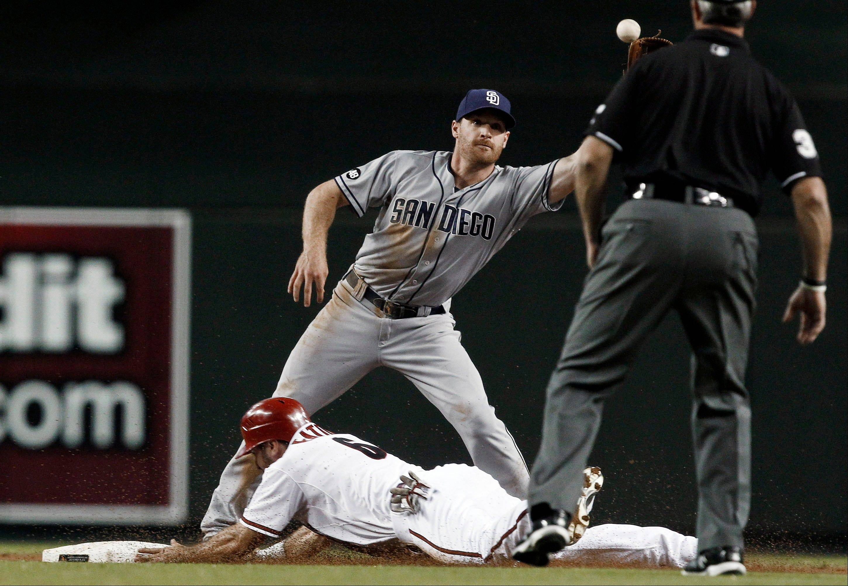 The Diamondbacks' Adam Eaton steals second base as San Diego's Logan Forsythe waits for a late throw during the first inning Tuesday in Phoenix.