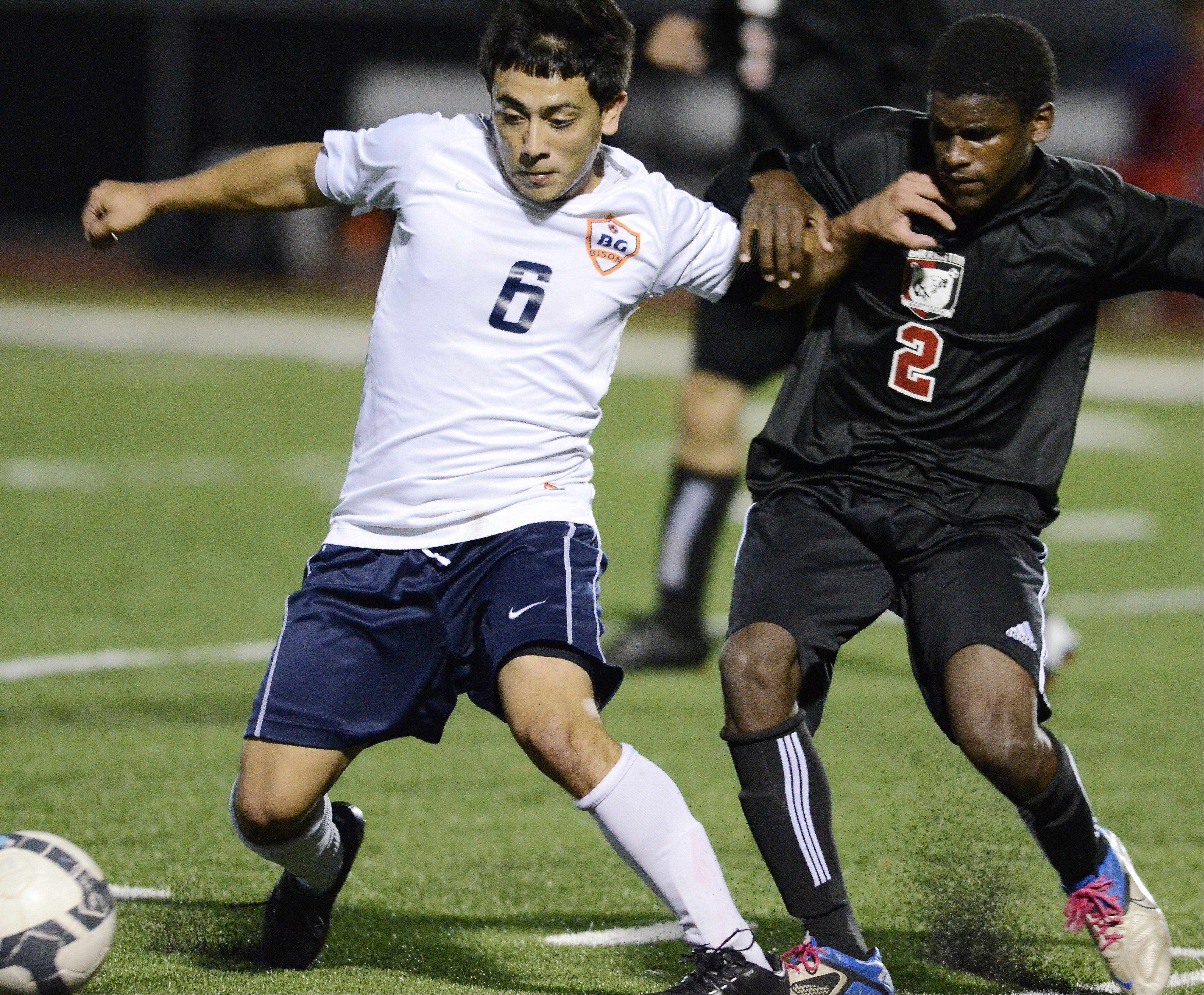 Buffalo Grove's Irving Eloiza, left, and Barrington's Kendall Stork make contact as they pursue the ball Tuesday.