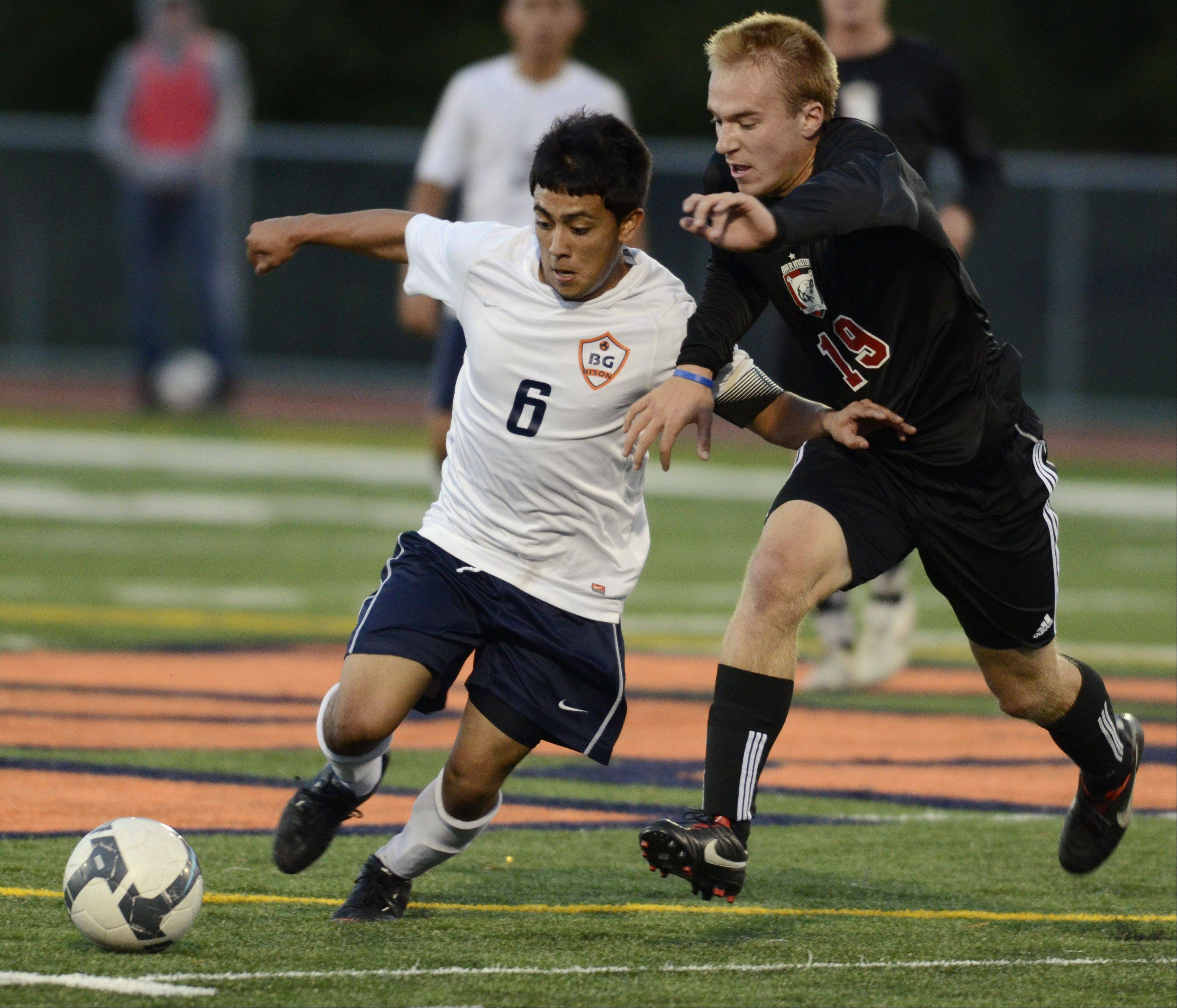 Buffalo Grove's Irving Eloiza, left, and Barrington's Craig Zahour pursue the ball during Tuesday's game.