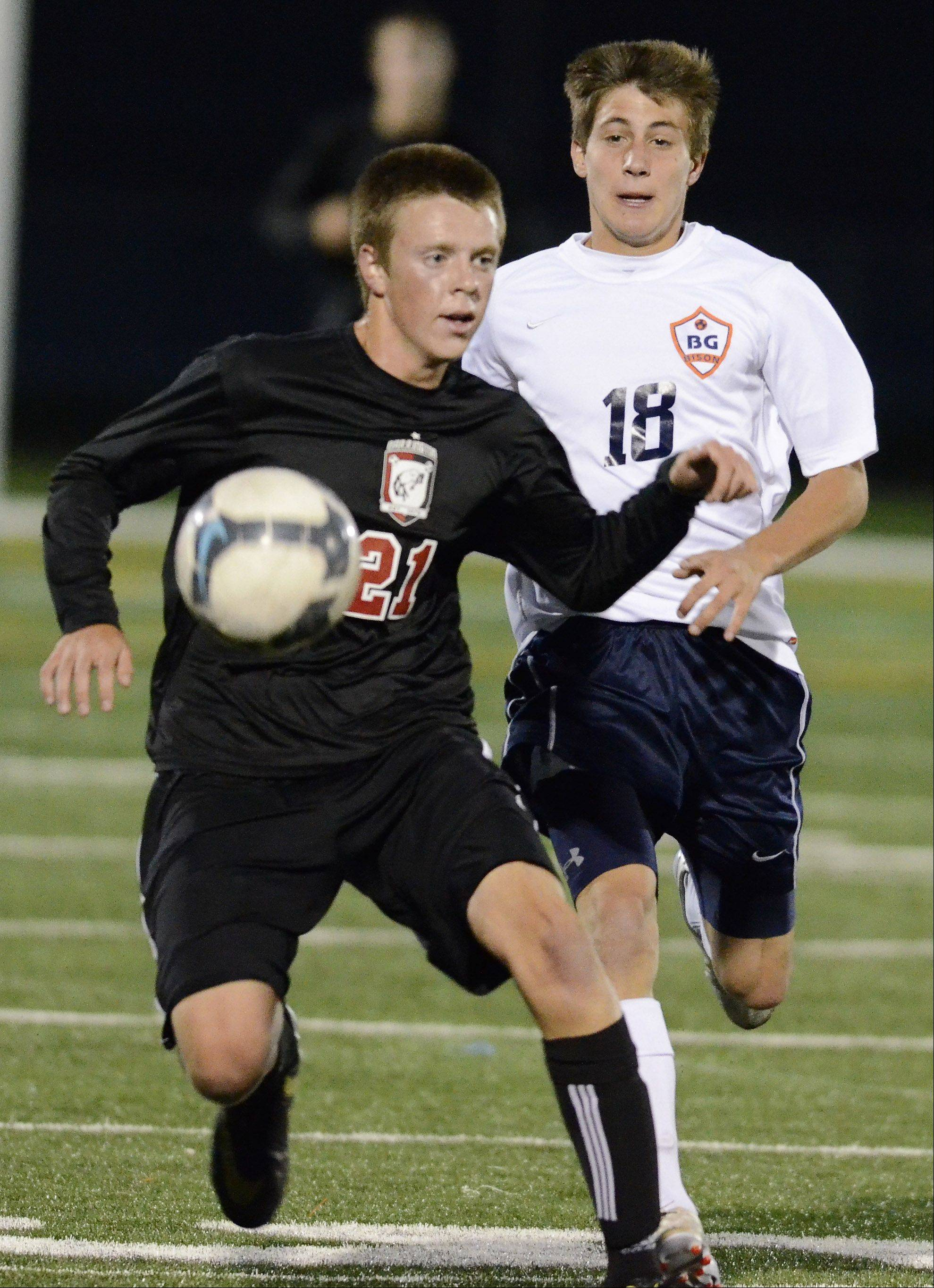 Barrington's Jason Frenk, left, looks for an open teammate as Buffalo Grove's Zach Masciopinto closes in during Tuesday's game.
