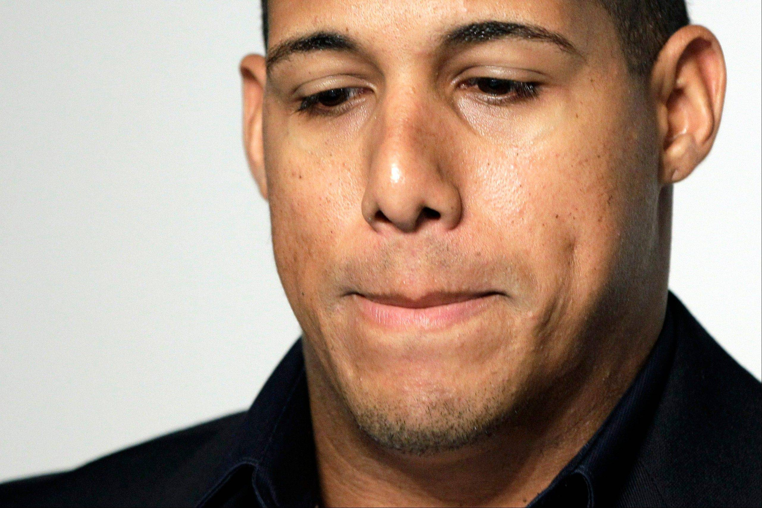 Toronto's Yunel Escobar pauses during a news conference Tuesday at Yankee Stadium in New York. Escobar was suspended for three games Tuesday by the Blue Jays for wearing eye-black displaying a homophobic slur written in Spanish during last Saturday's game against the Boston Red Sox.