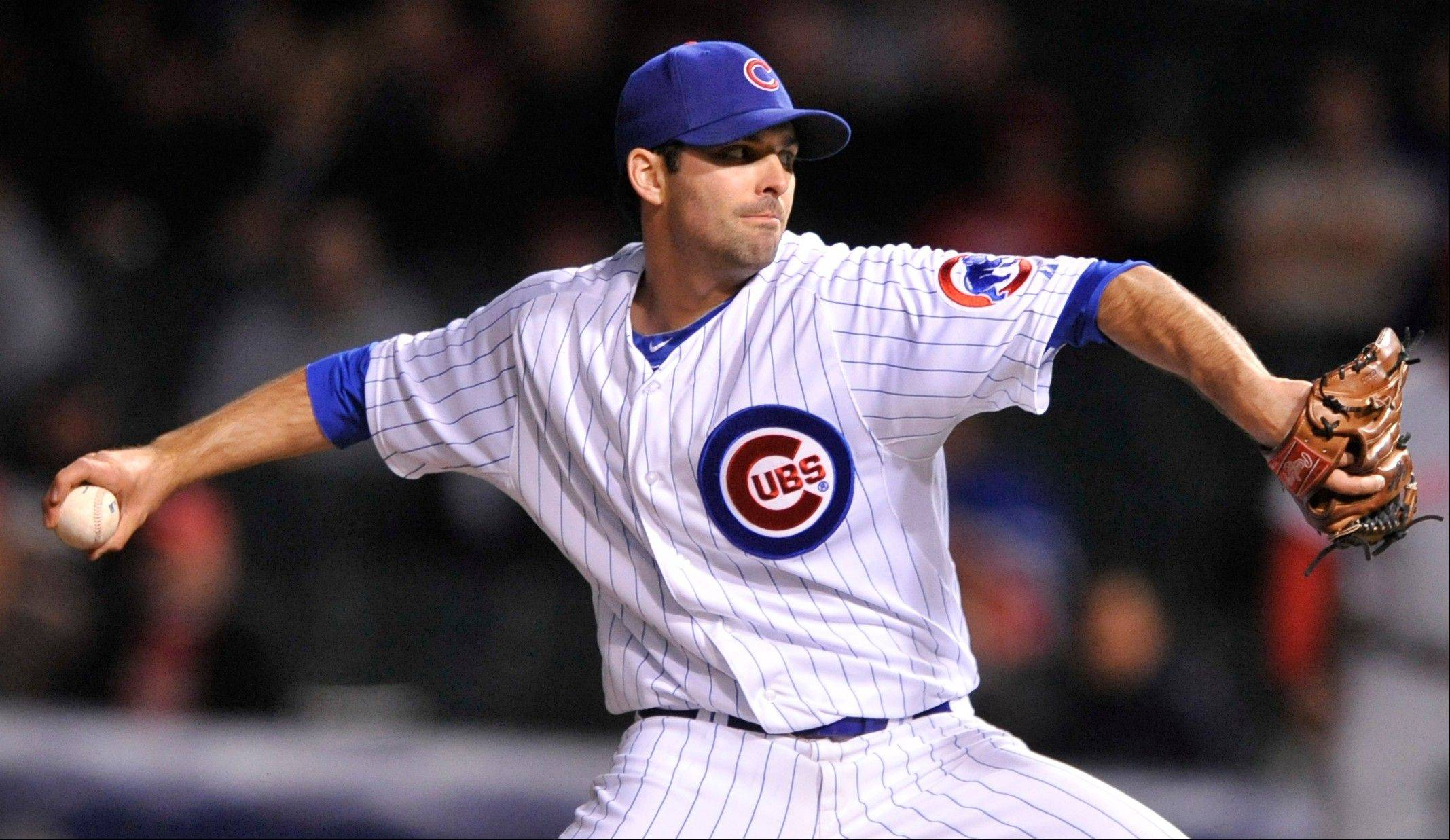 Cubs starter Justin Germano delivers a pitch in the first inning during a baseball game against the Cincinnati Reds in Chicago, Tuesday, Sept. 18, 2012.
