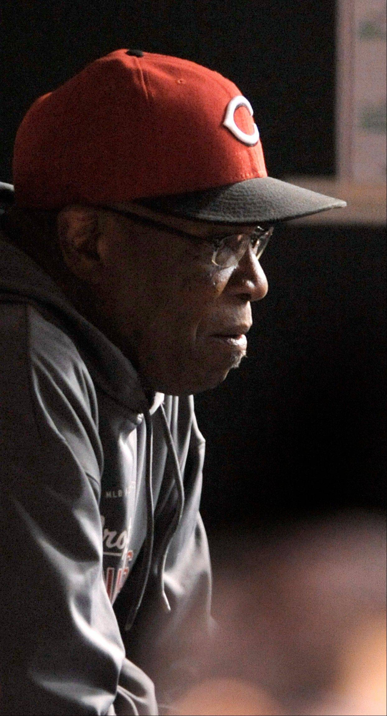 Cincinnati Reds manager Dusty Baker sits in the dugout during the second inning of a baseball game between the Reds and the Chicago Cubs in Chicago, Tuesday, Sept. 18, 2012. The game is Baker's 3,000th as a manager in the majors.