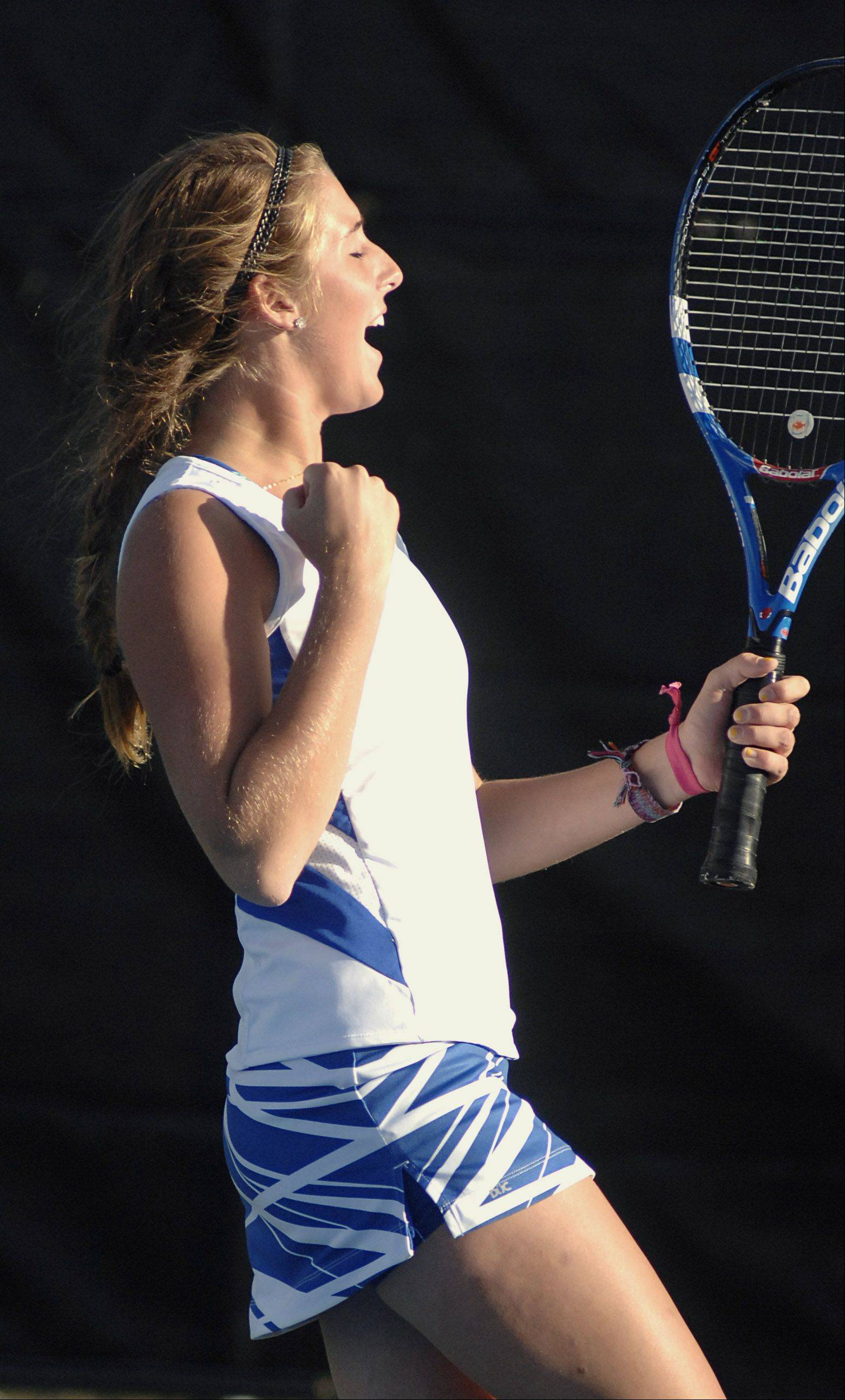 St. Charles North's Ashley Randazzo pumps her fist after scoring over St. Charles East in the first doubles match on Tuesday, September 18.