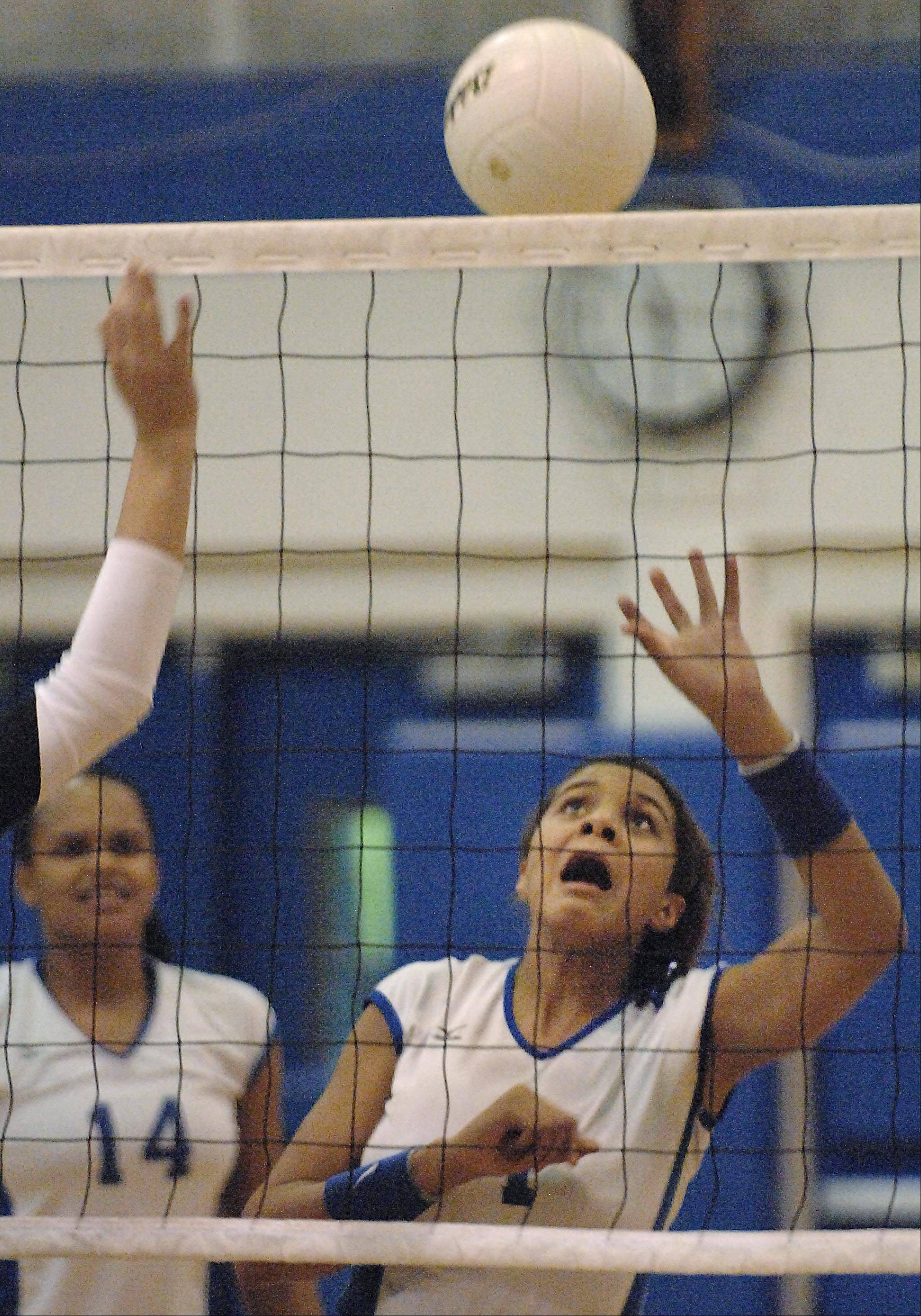 Larkin's Olivia Kofie reacts for a rebound of her kill shot against Elgin Tuesday at Larkin High School in Elgin.