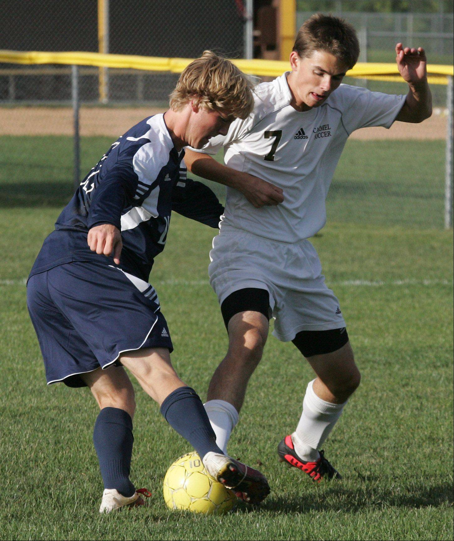 St. Viator midfielder Jackson Owens battles Carmel defender Tommy Paslaski on Tuesday in Mundelein.