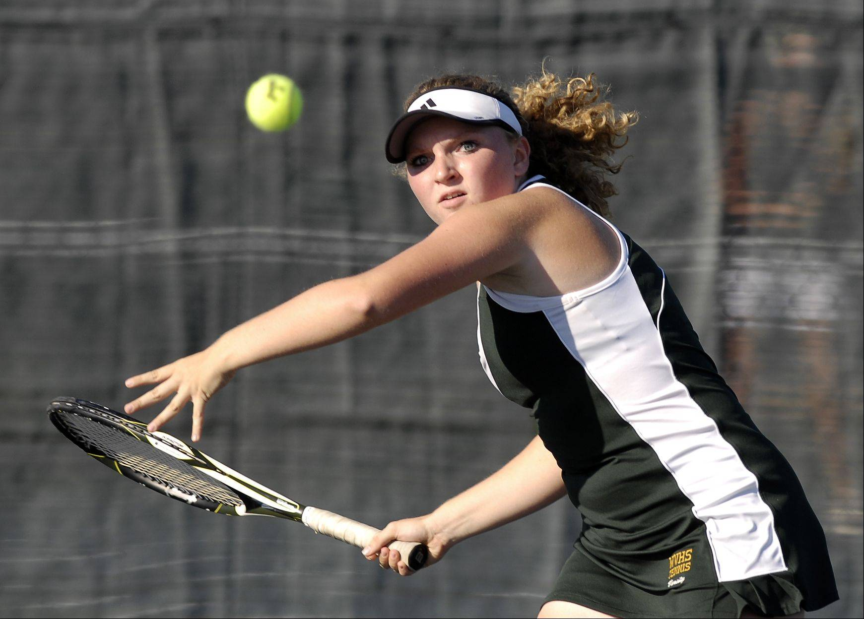 Waubonsie Valley's Katie Drone keeps a sharp eye on the ball during her tennis match against St. Charles East's Sarah Church Wednesday in Auroroa.