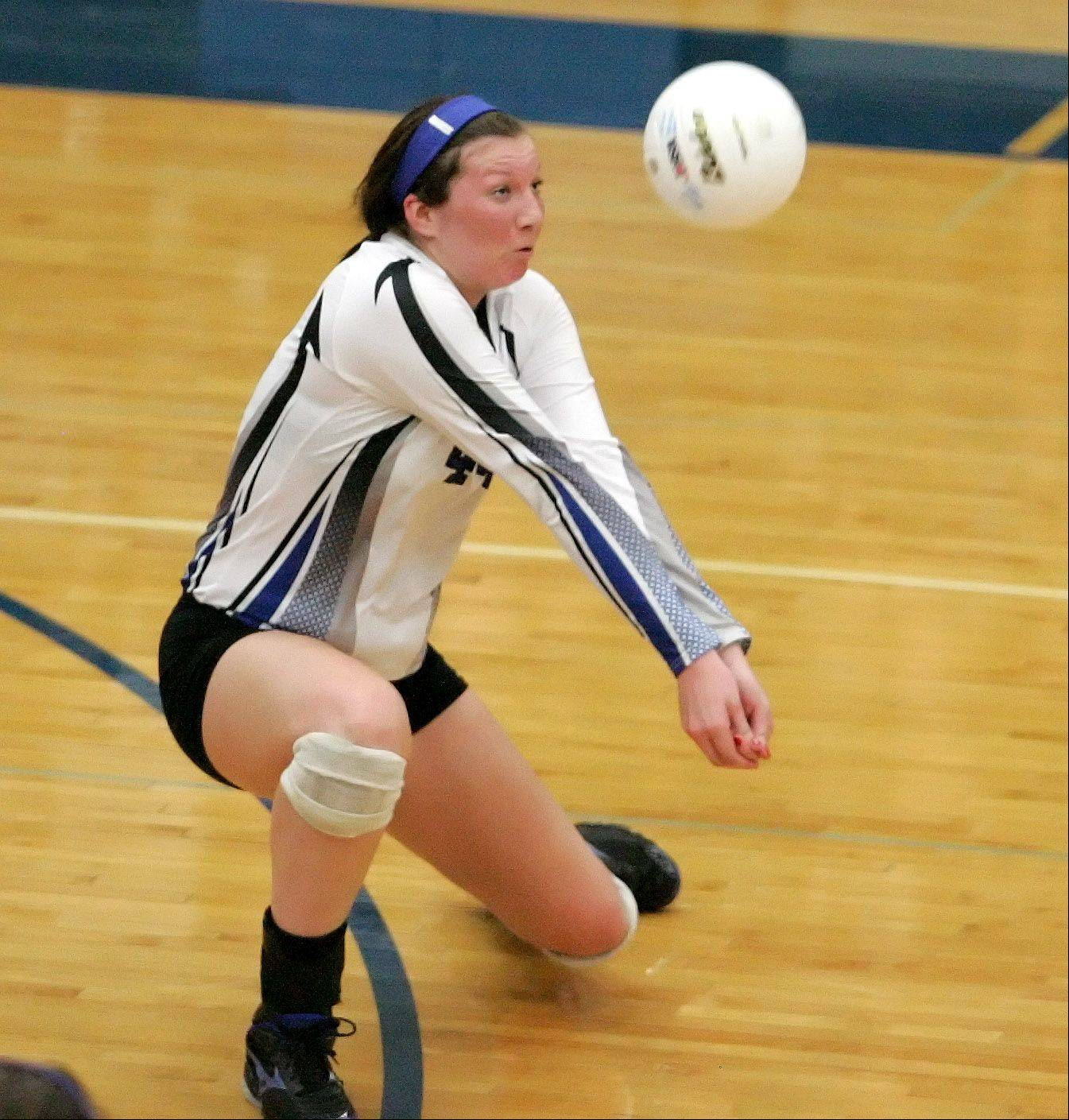 Maddie Haggerty of St. Francis digs in against Rosary during Monday's volleyball game in Wheaton.