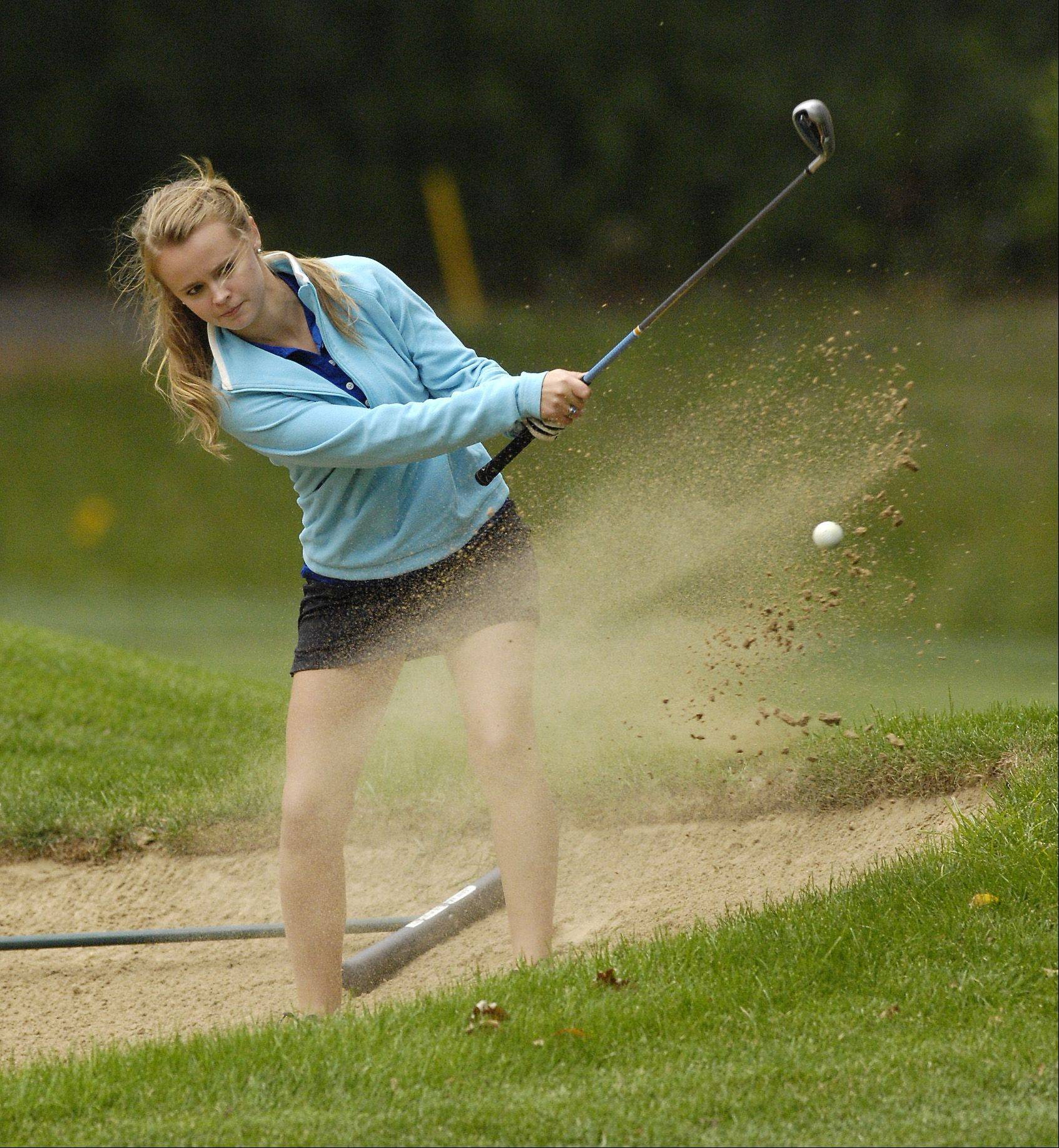 St. Francis' Sarah Pinns hits out of a bunker during a golf match against Providence Catholic in Wheaton on Thursday.