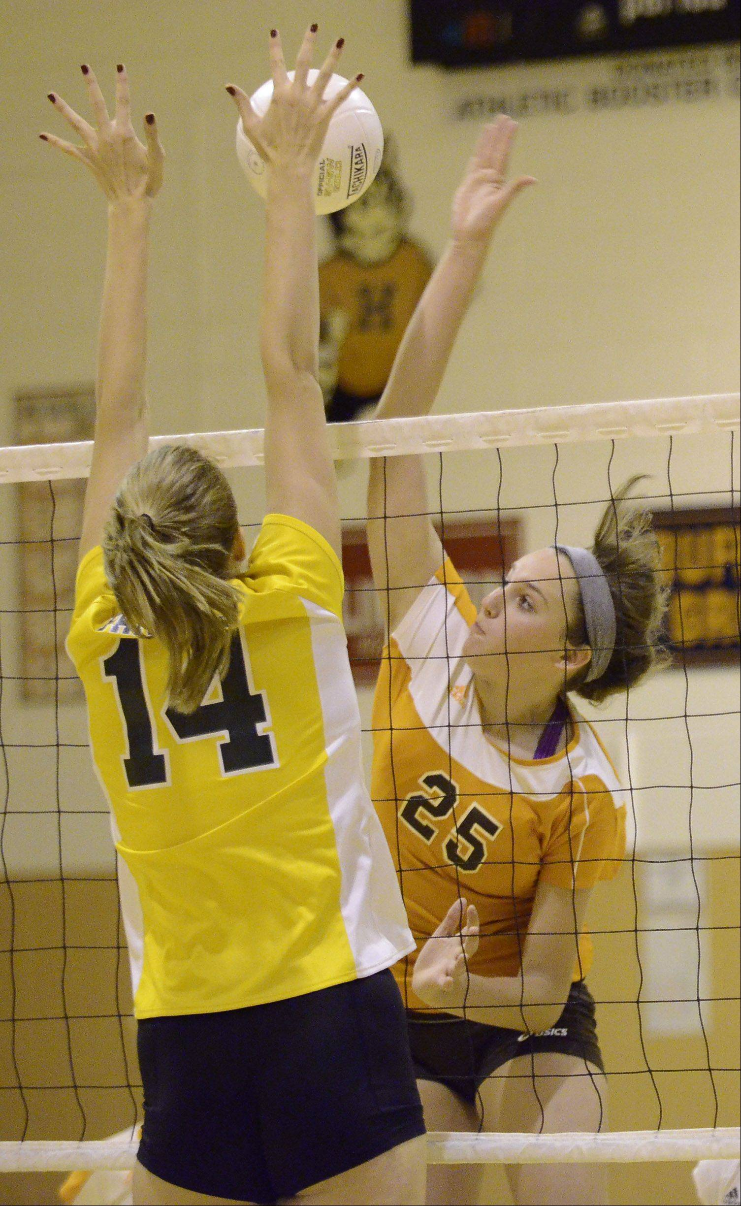Hersey's Gabriella Olhava, 25, gets a kill against Stevenson's Kara Maleski Monday night at Hersey.