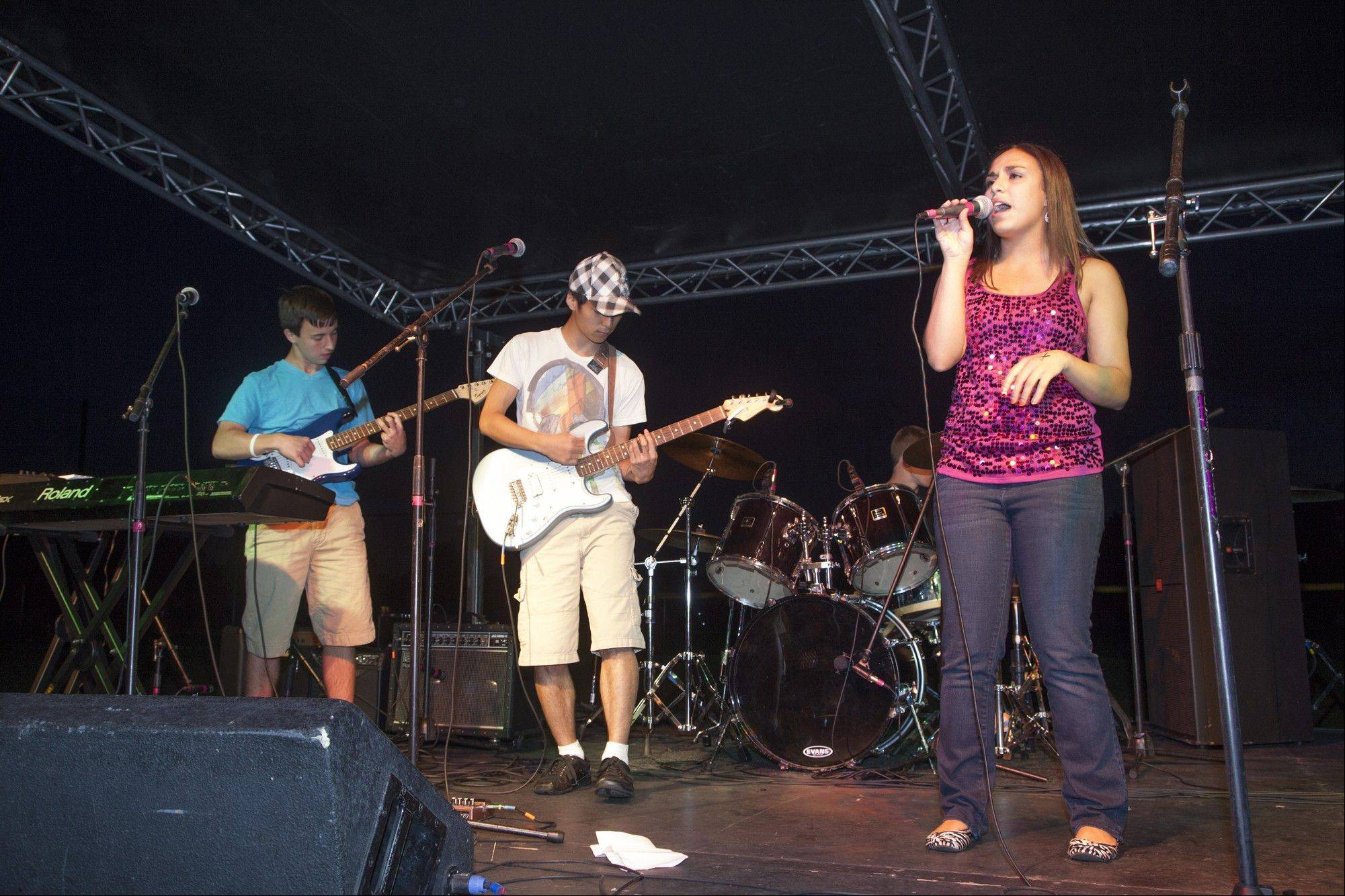 Sara Fecko, right, sings lead vocals with bandmates Bobby Gallant, left, and Yoon Chang.