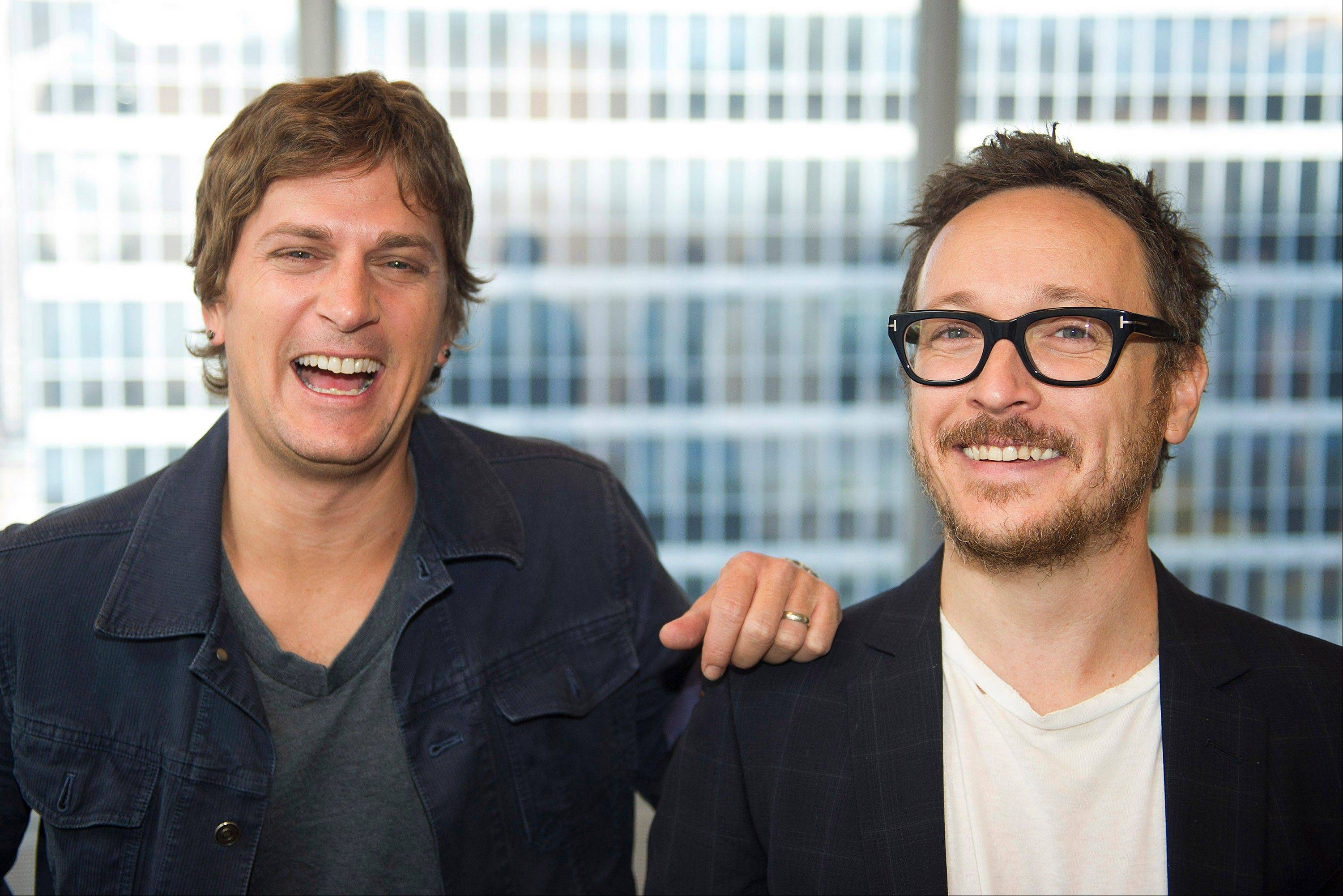 "Rob Thomas, left, and Paul Doucette of Matchbox Twenty celebrate the release of the band's new album, ""North,"" which debuted at No. 1 on Billboard's 200 albums chart this week. It is the band's first full-length album since 2002's ""More Than You Think You Are."""