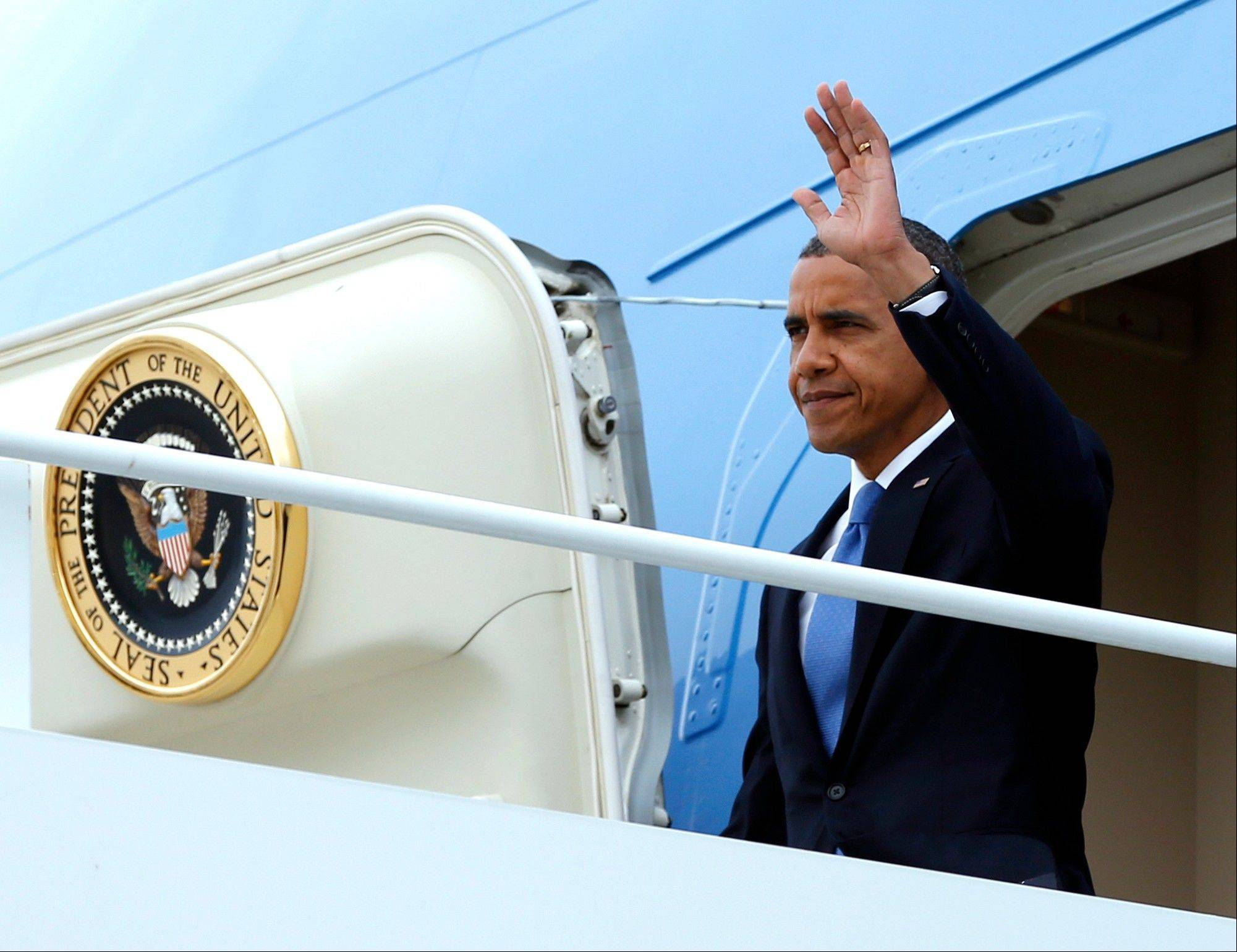 President Barack Obama waves as he arrives on Air Force One at John F. Kennedy International Airport, Tuesday, Sept. 18, 2012, in New York.