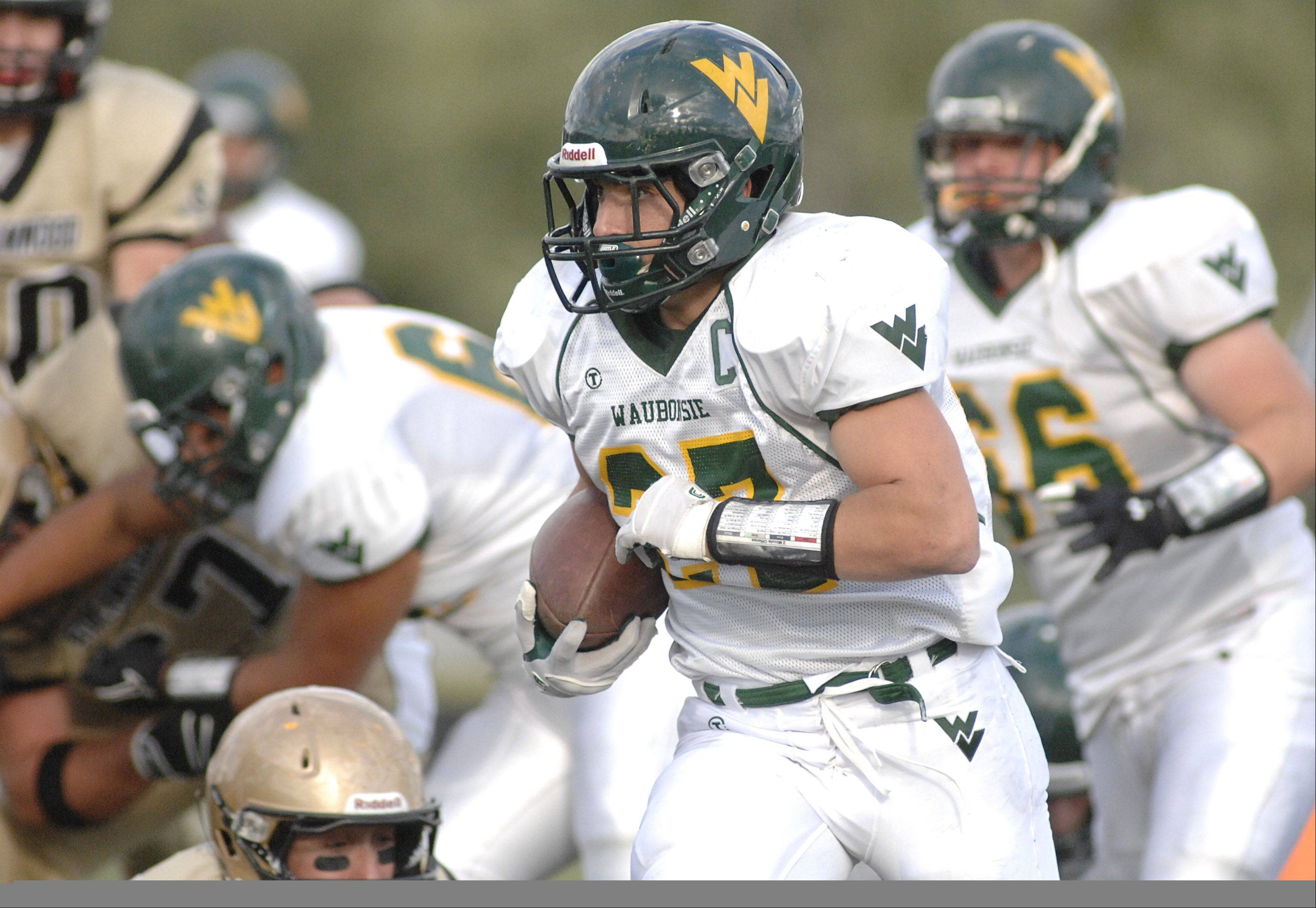 Waubonsie Valley's Austin Guido races down the field to score a touchdown in the second quarter vs Streamwood on Saturday, September 8.