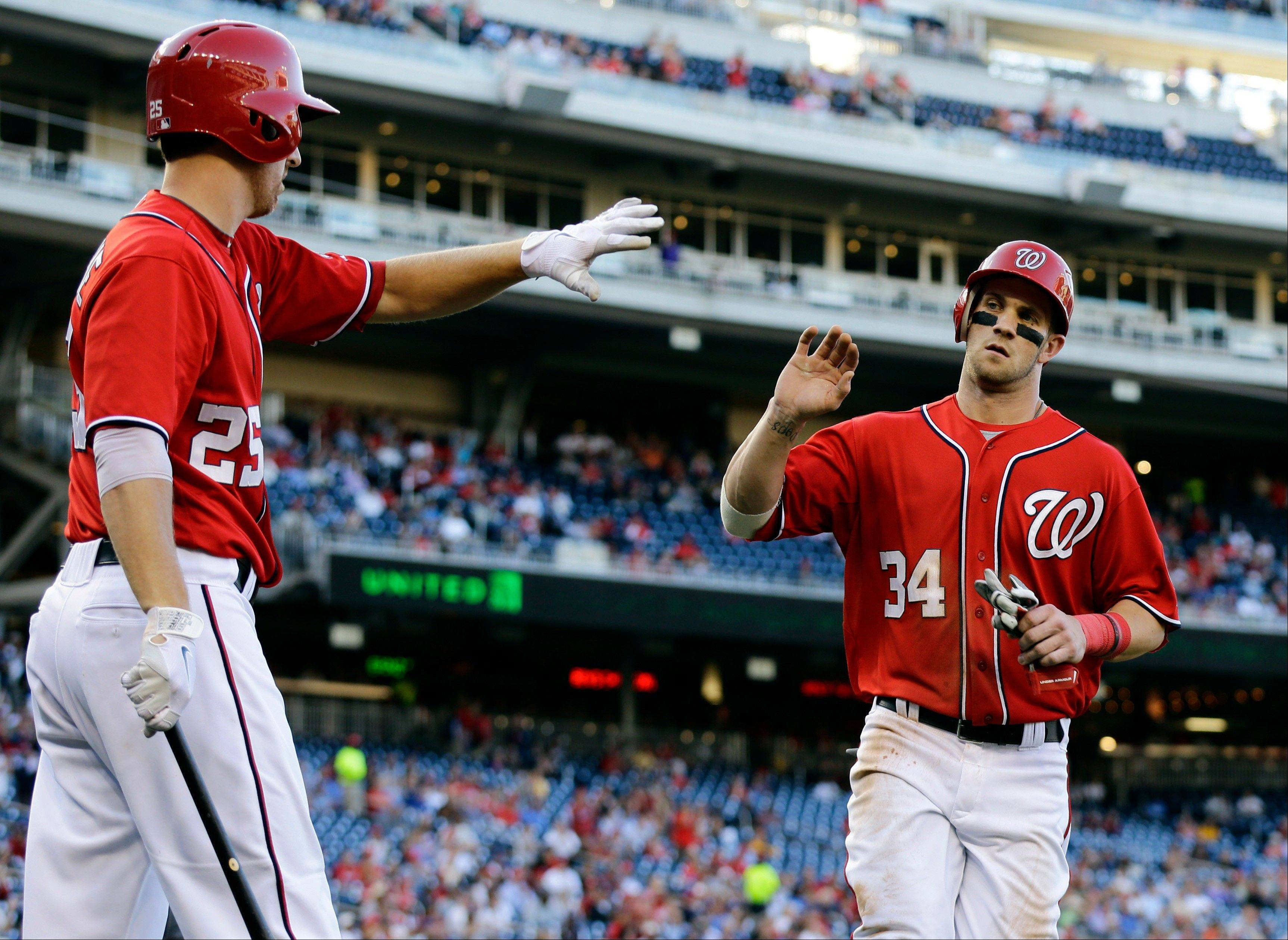 Washington Nationals outfielder Bryce Harper celebrates Wednesday with Adam LaRoche during the fifth inning oagainst the Los Angeles Dodgers at Nationals Park.