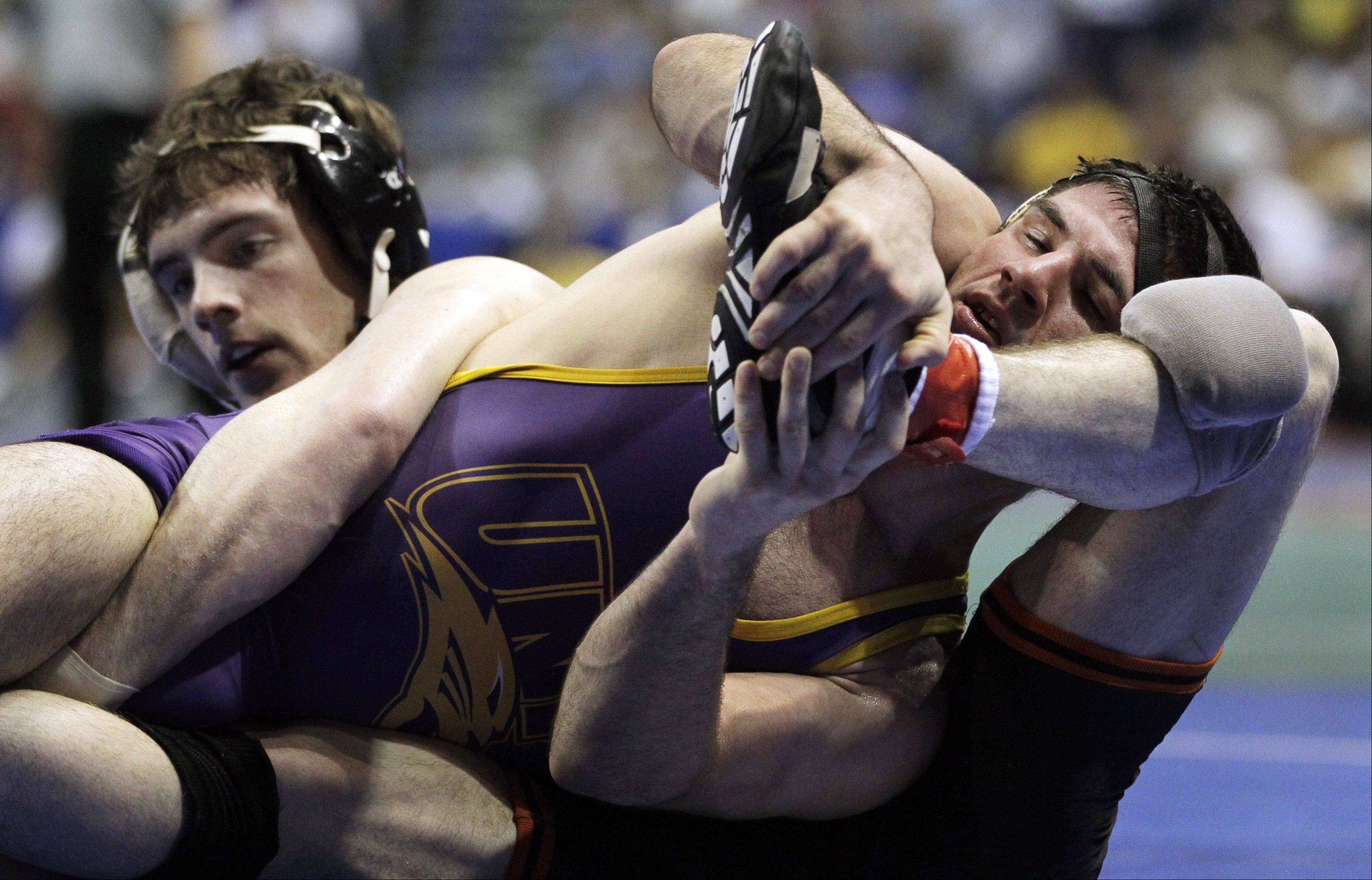 Northern Iowa's David Bonin, right, grapples with Princeton's Daniel Kolodzik during their 157-pound second round match March 15 at the NCAA Division I Wrestling Championships in St Louis. Northern Iowa, along with Missouri and Old Dominion University, has decided to join the Mid-American Conference in wrestling only.